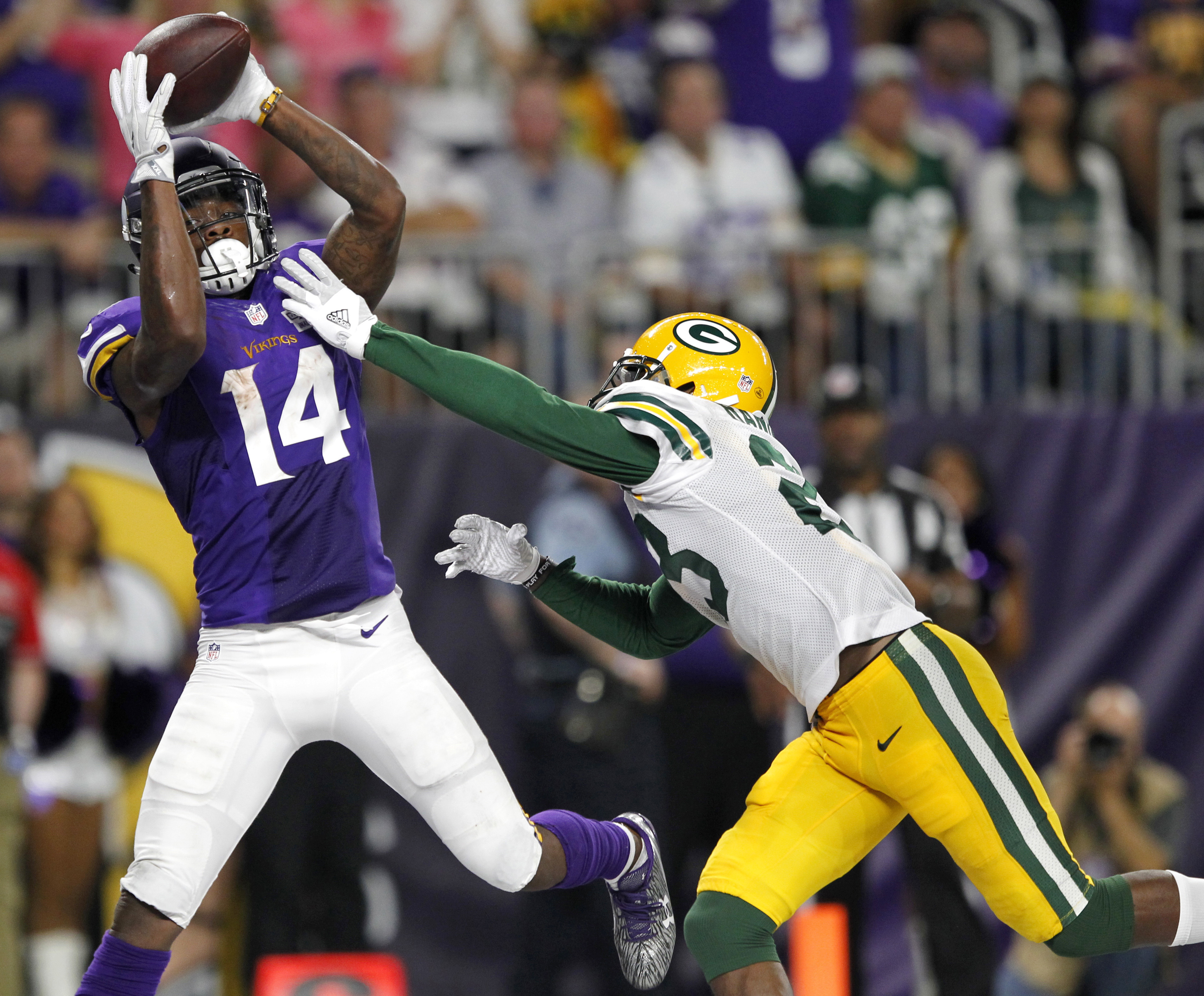 FILE - In this Sept. 18, 2016, file photo, Minnesota Vikings wide receiver Stefon Diggs (14) catches a 25-yard touchdown pass over Green Bay Packers cornerback Damarious Randall, right, during the second half of an NFL football game in Minneapolis.  The D