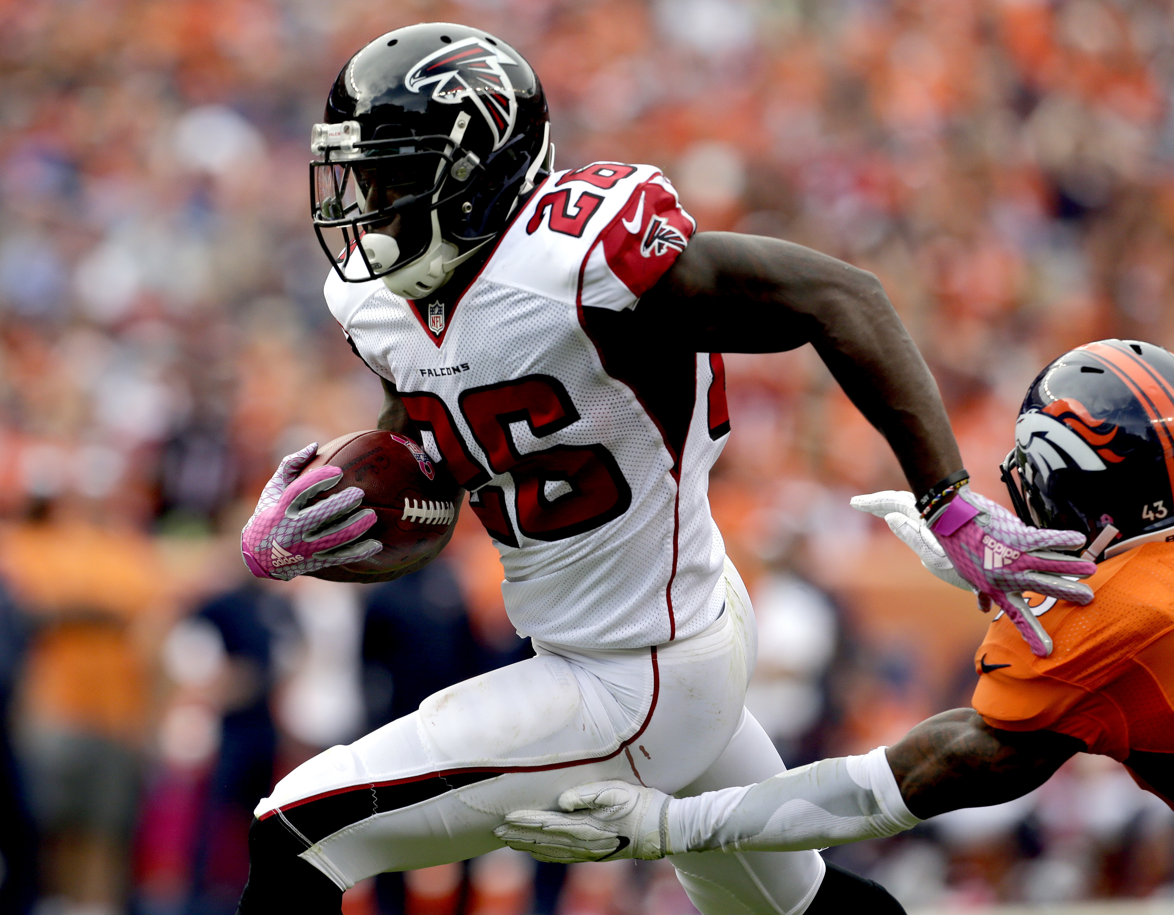 FILE - In this Oct. 9, 2016, file photo, Atlanta Falcons running back Tevin Coleman (26) runs for a touchdown against the Denver Broncos during the second half of an NFL football game, in Denver. After missing three games with a hamstring injury, Coleman