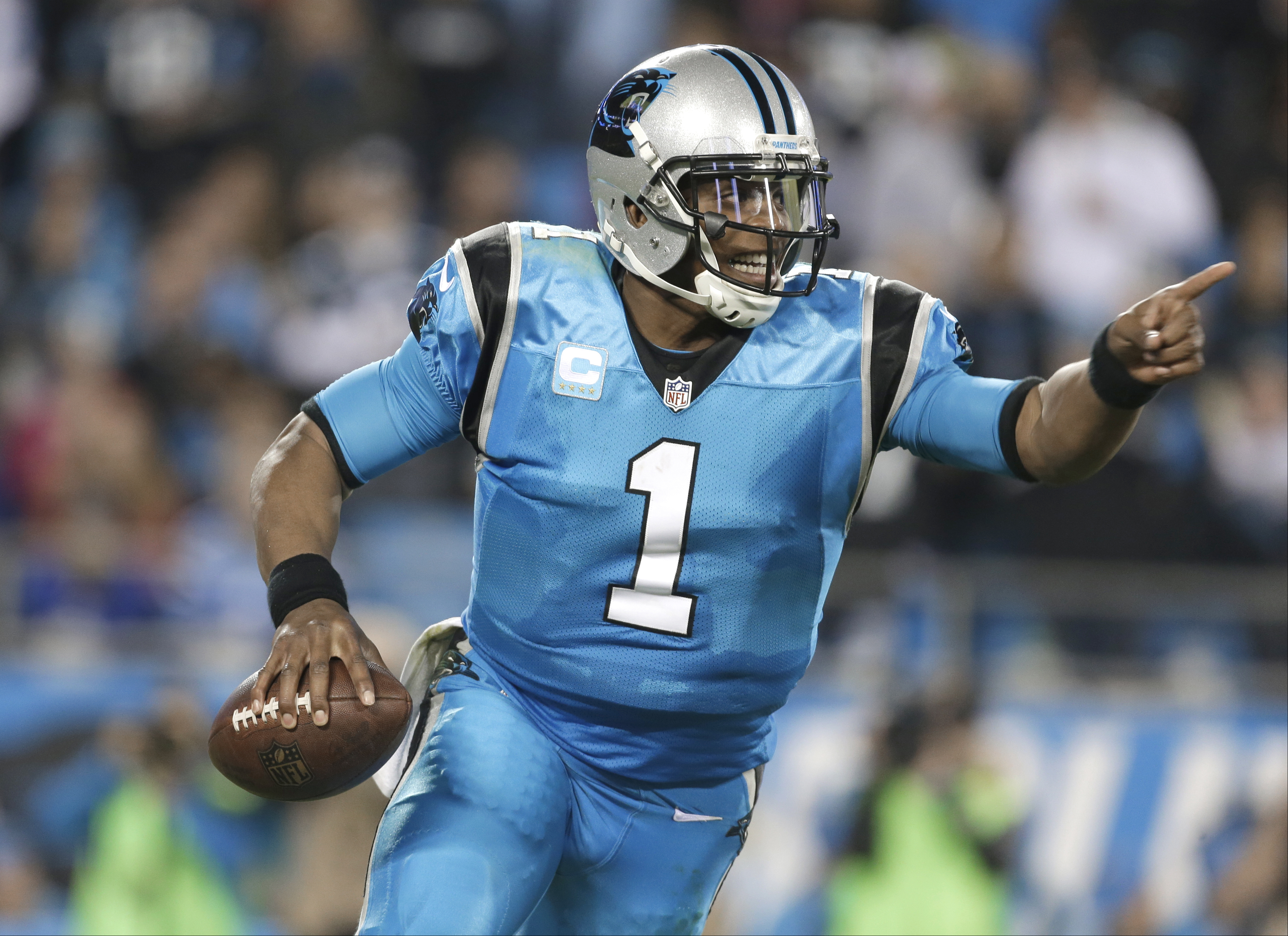 FILE - In this Thursday, Nov. 17, 2016 file photo, Carolina Panthers' Cam Newton (1) scrambles against the New Orleans Saints in the second half of an NFL football game in Charlotte, N.C. Cam Newtons numbers this season are pedestrian at best, a far cry f