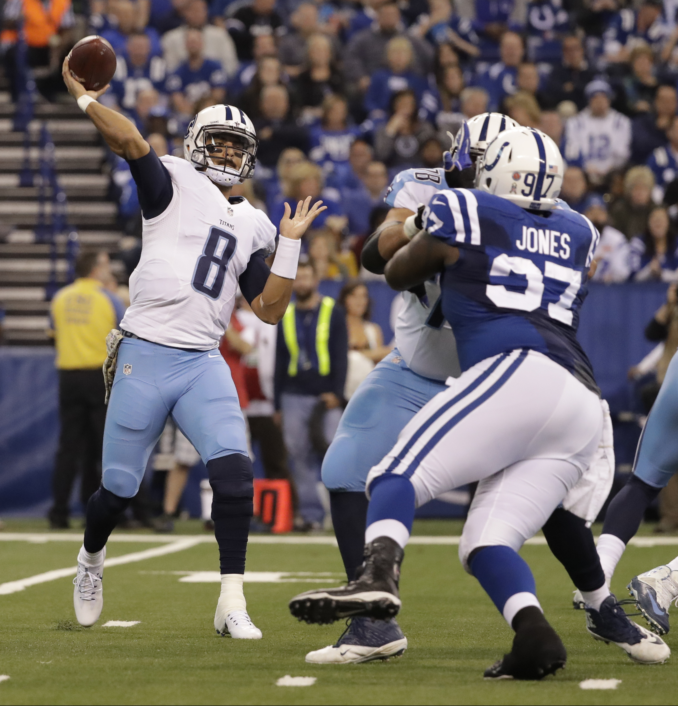 FILE -- In this Nov. 20, 2016, file photo, Tennessee Titans quarterback Marcus Mariota (8) throws against the Indianapolis Colts during an NFL football game in Indianapolis. The Titans have not turned the ball over in two straight games, and wide receiver
