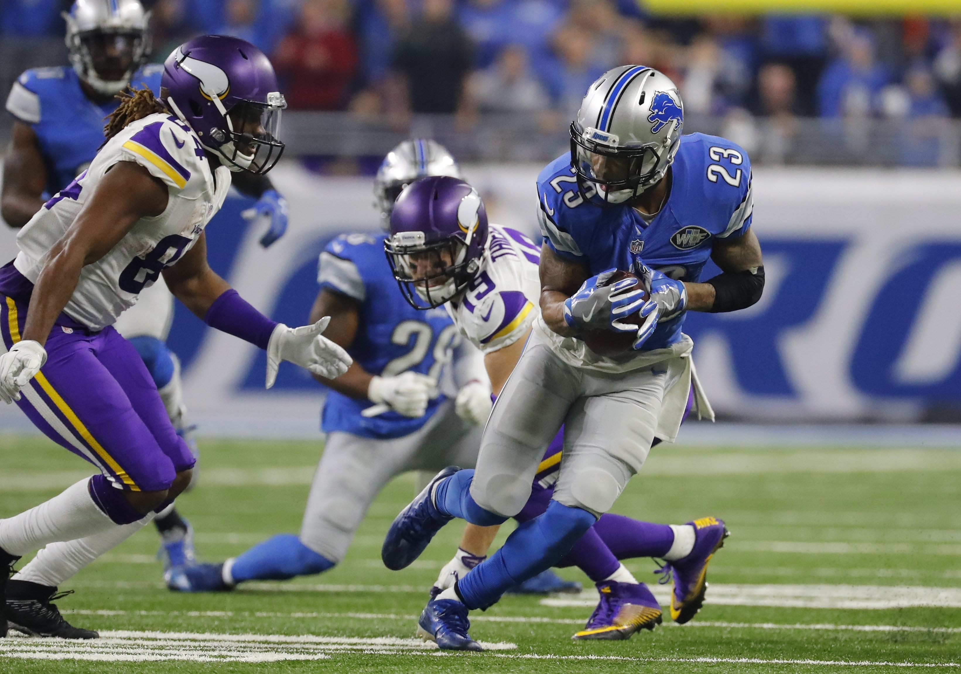 Detroit Lions cornerback Darius Slay (23) intercepts a pass intended for Minnesota Vikings wide receiver Adam Thielen (19) during the second half of an NFL football game, Thursday, Nov. 24, 2016 in Detroit. (AP Photo/Rick Osentoski)