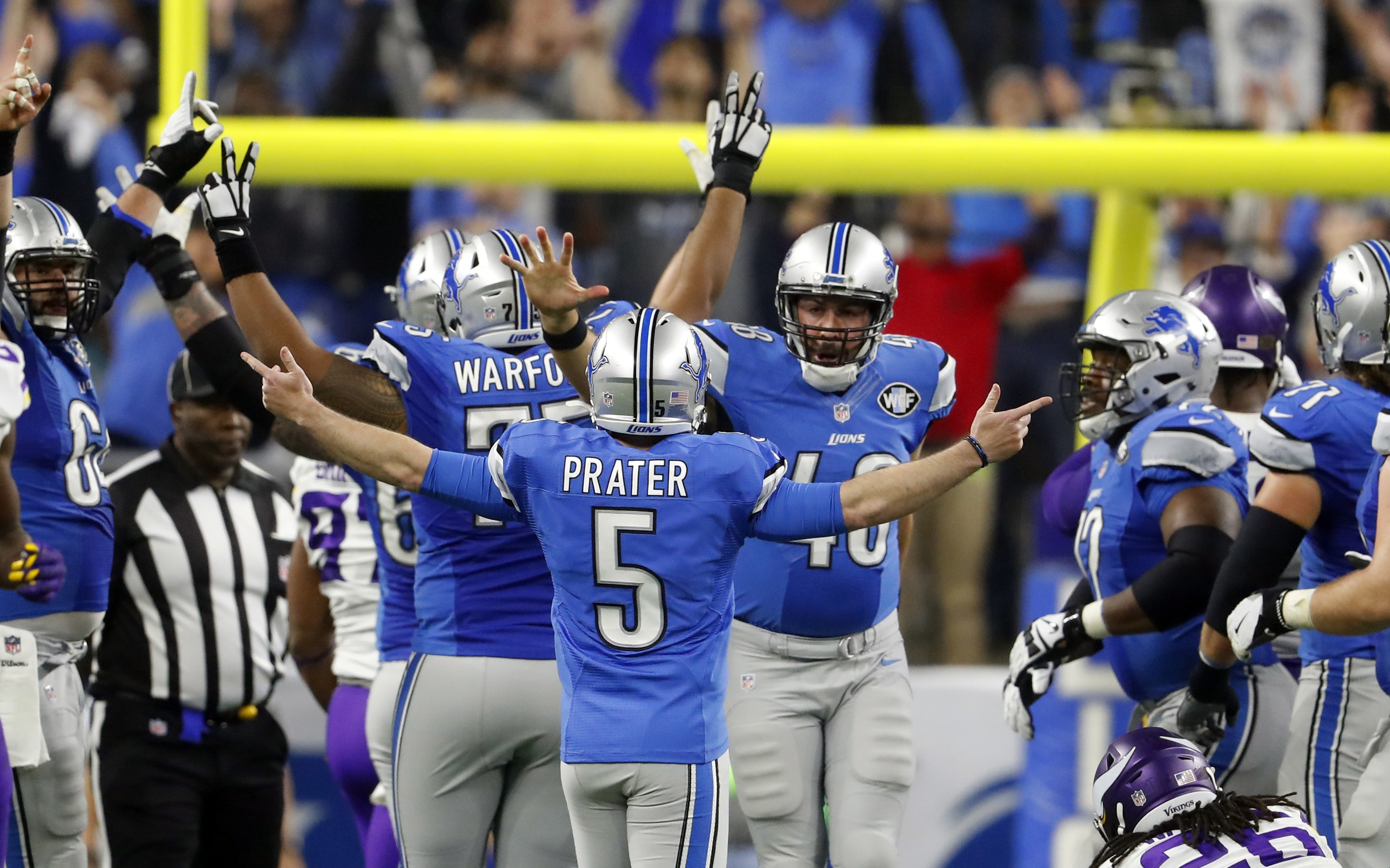 Detroit Lions kicker Matt Prater (5) is congratulated after making a 40-yard winning field goal during the second half of an NFL football game against the Minnesota Vikings, Thursday, Nov. 24, 2016, in Detroit. (AP Photo/Paul Sancya)
