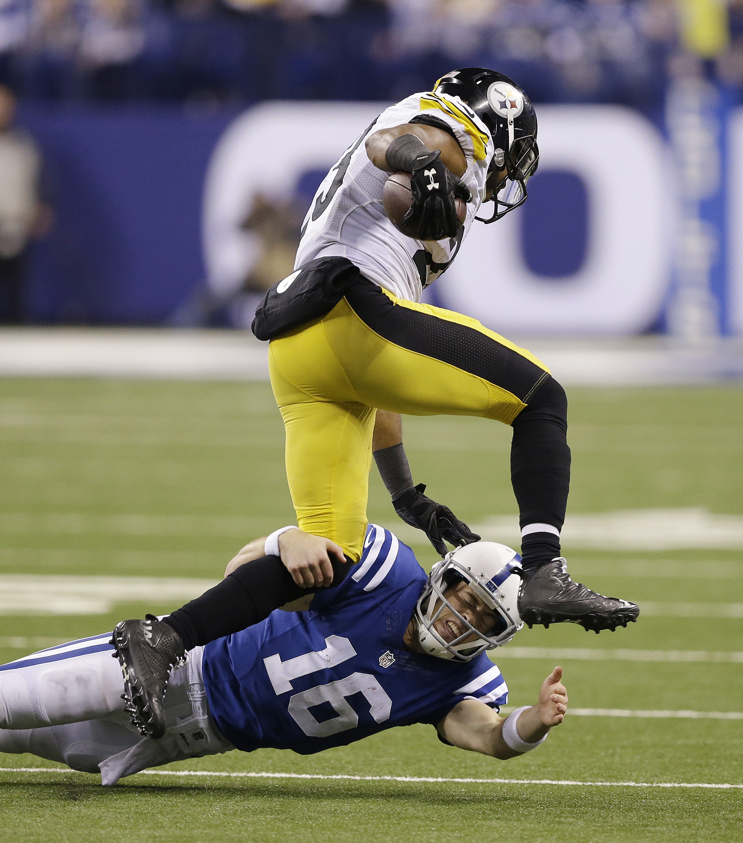 Indianapolis Colts quarterback Scott Tolzien (16) tackles Pittsburgh Steelers' Mike Mitchell (23) after Mitchell made an interception during the second half of an NFL football game Thursday, Nov. 24, 2016, in Indianapolis. (AP Photo/Michael Conroy)