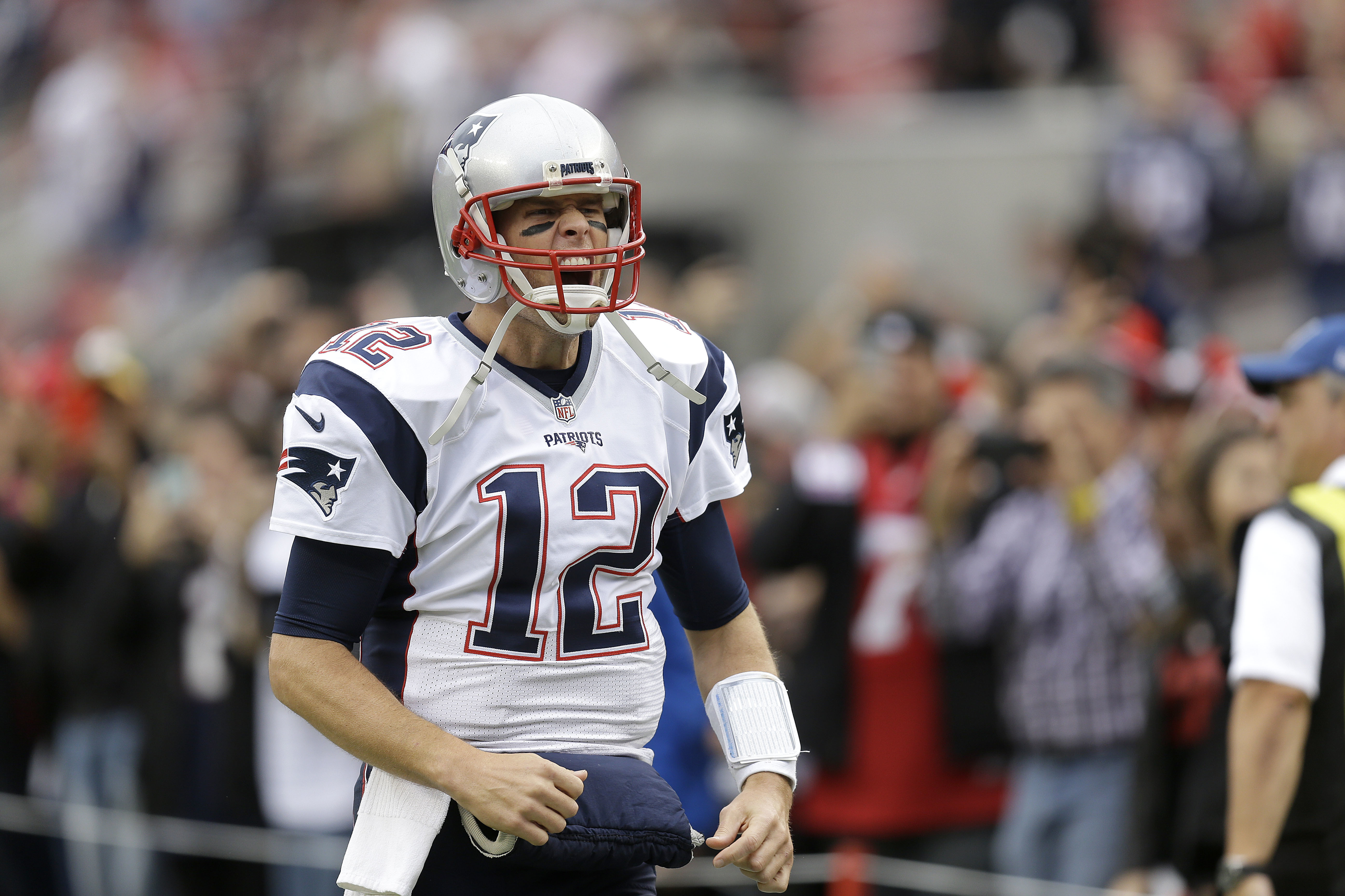 FILE  - In this Sunday, Nov. 20, 2016 file photo, New England Patriots quarterback Tom Brady (12) yells while warming up before an NFL football game against the San Francisco 49ers in Santa Clara, Calif. Brady could achieve a few more milestones this week