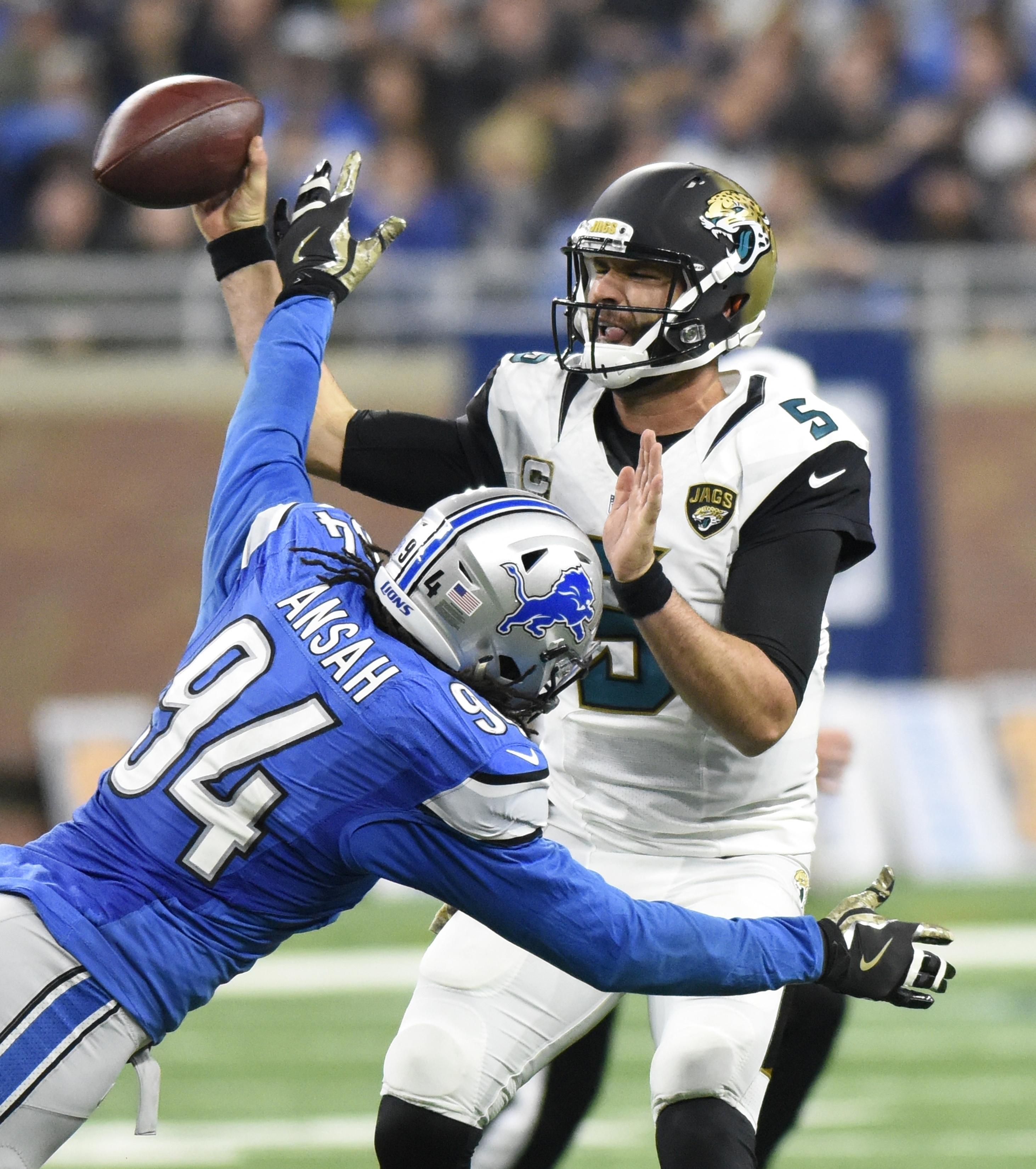 FILE - In this Nov. 20, 2016, file photo, Jacksonville Jaguars quarterback Blake Bortles (5) is rushed by Detroit Lions defensive end Ezekiel Ansah (94) during an NFL football game in Detroit. Jacksonville plays at the Buffalo Bills this week. (AP Photo/J