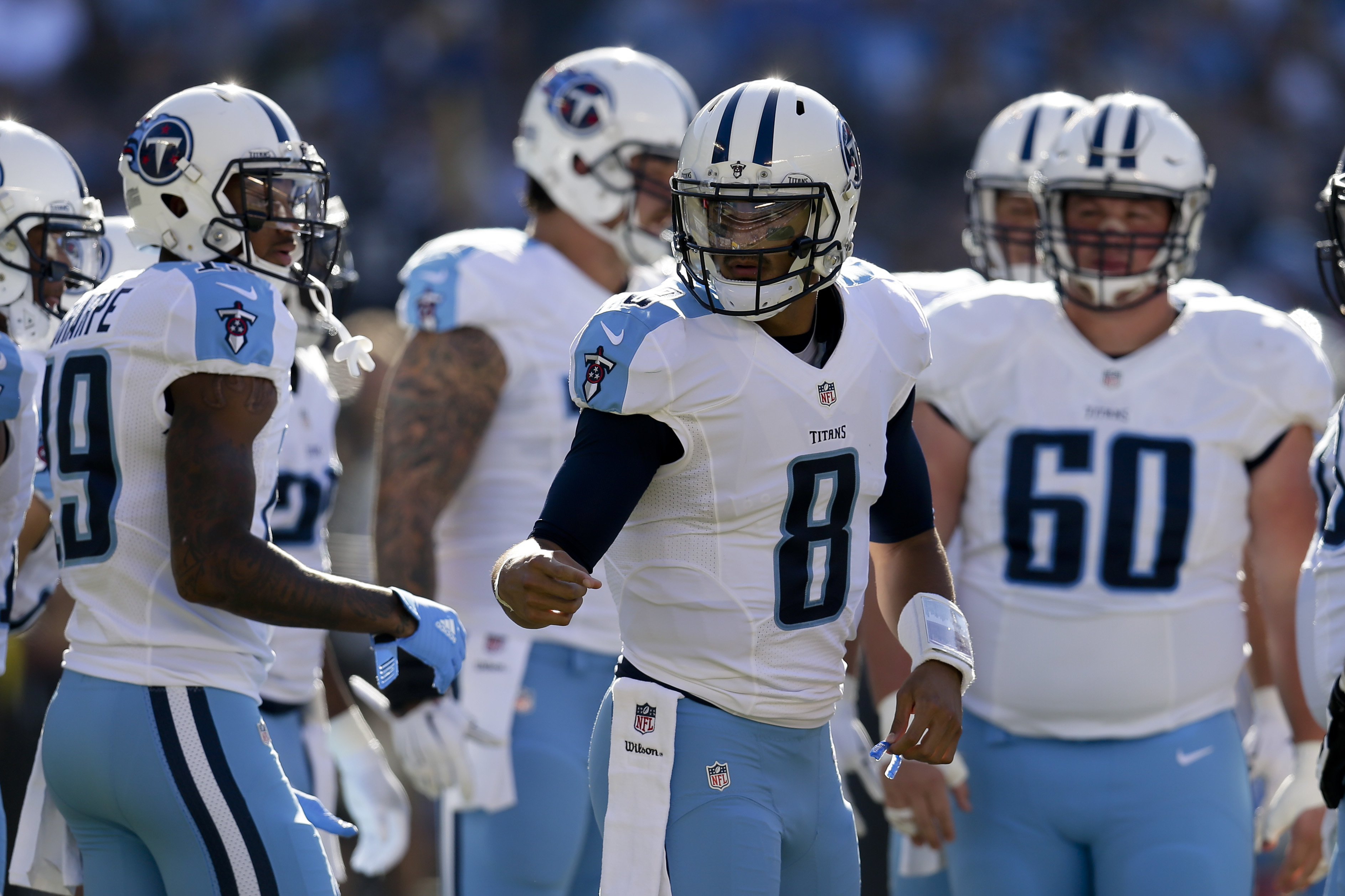 FILE - In this Nov. 6, 2016, file photo, Tennessee Titans quarterback Marcus Mariota motions in the huddle during the first half of an NFL football game against the San Diego Chargers, in San Diego. The Titans second-year quarterback is putting together o