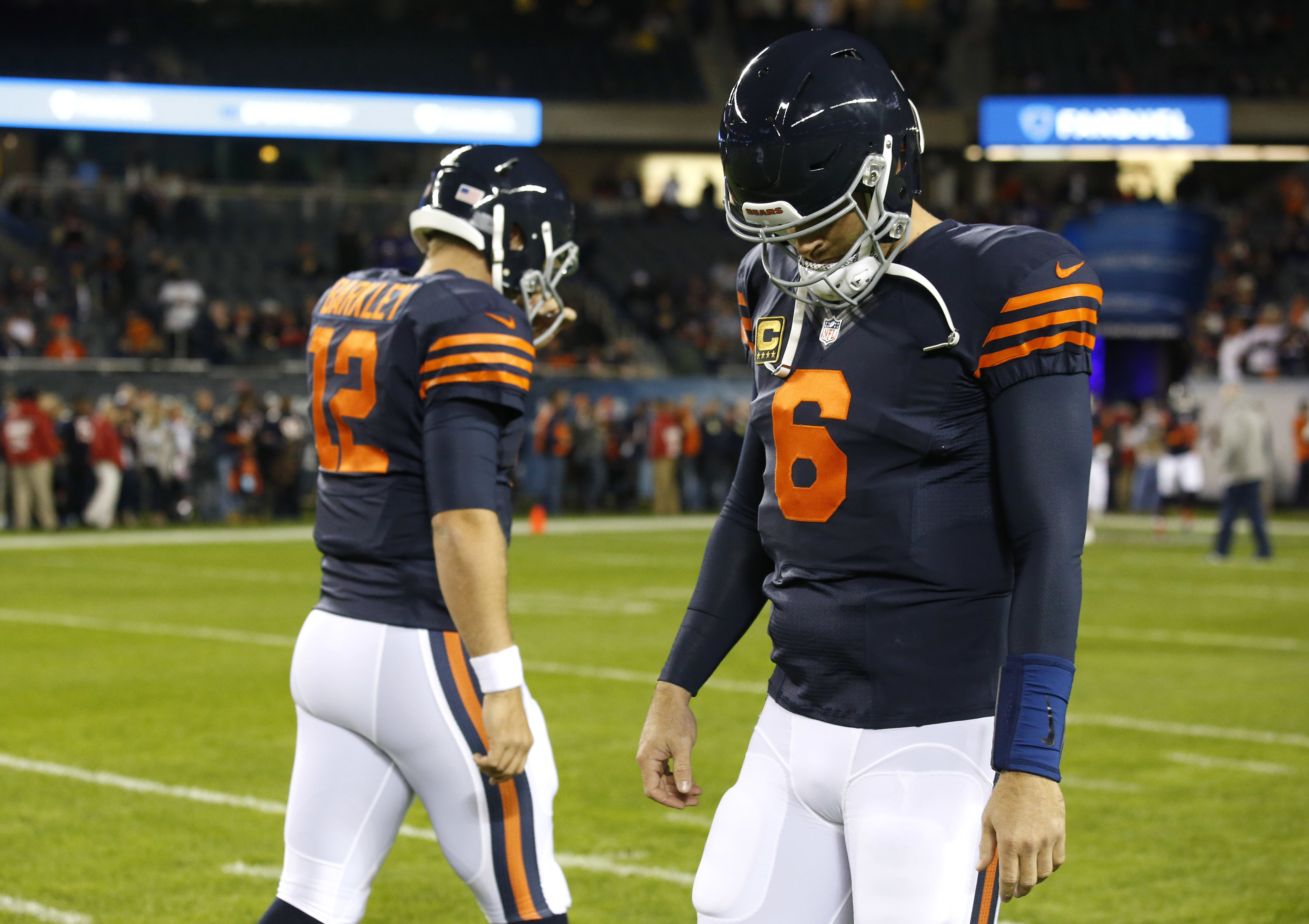 FILE - In this Oct. 31, 2016, file photo, Chicago Bears quarterbacks Matt Barkley (12) and Jay Cutler (6) walk on the field during warmups before an NFL football game against the Minnesota Vikings, in Chicago. The Titans (5-6) likely will be facing Matt B