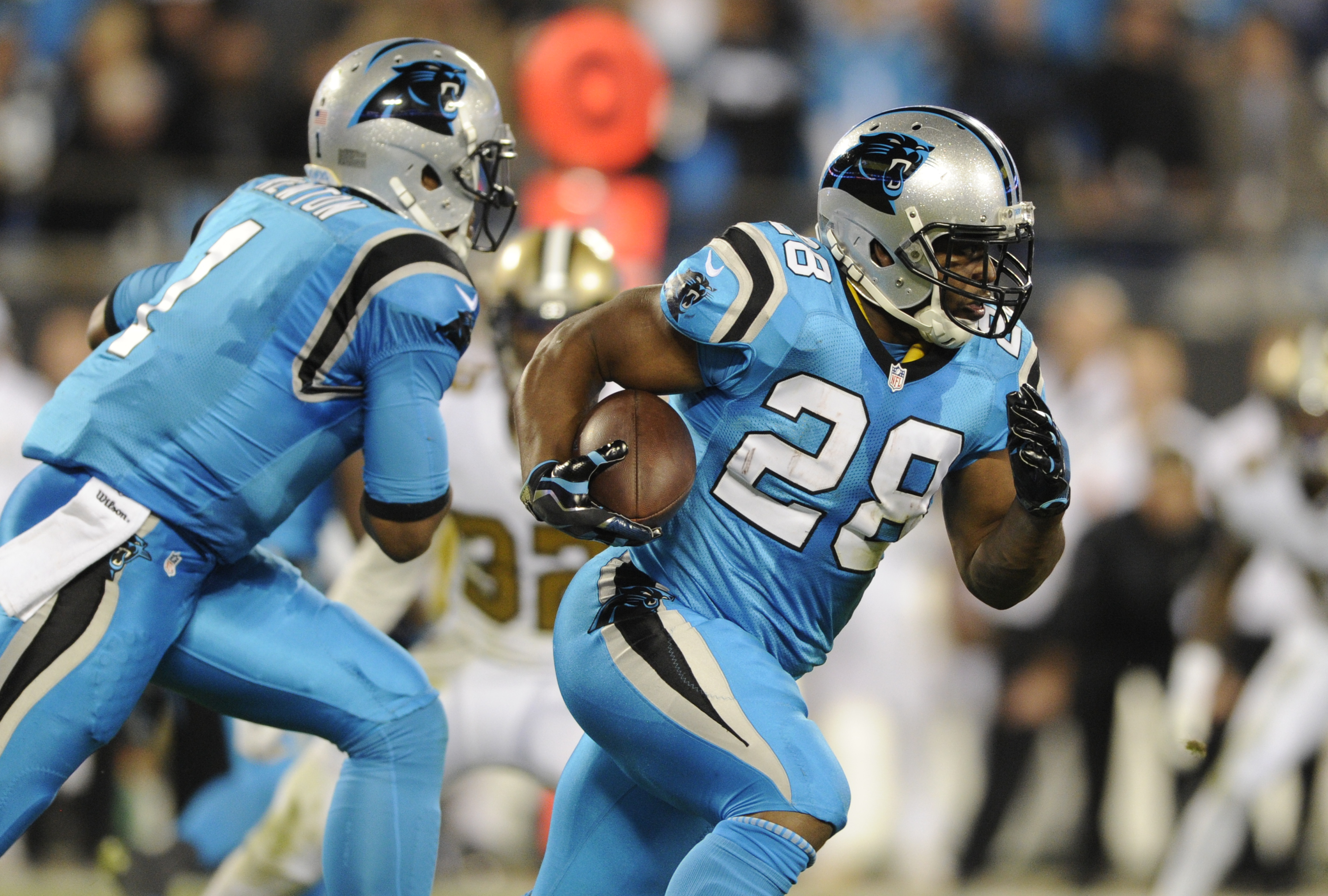 FILE - In this Nov. 17, 2016, file photo, Carolina Panthers' Jonathan Stewart (28) runs against the New Orleans Saints during an NFL football game in Charlotte, N.C. At left is quarterback Cam Newton. The Panthers play the Oakland Raiders this week. The P