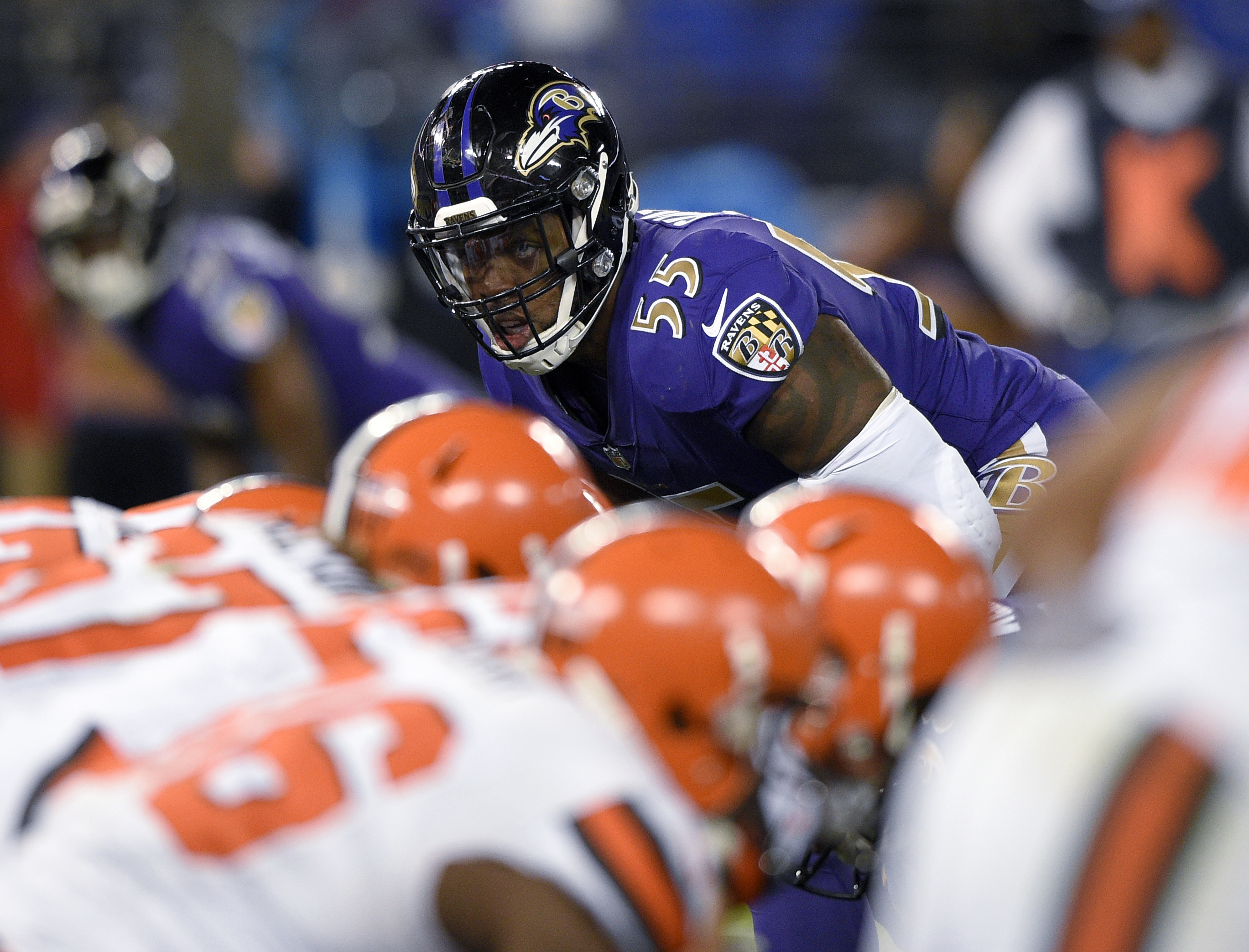 FILE - In this Nov. 10, 2016, file photo, Baltimore Ravens outside linebacker Terrell Suggs (55) looks across the line of scrimmage during the team's NFL football game against the Cleveland Browns in Baltimore. The Ravens need a victory against the Bengal