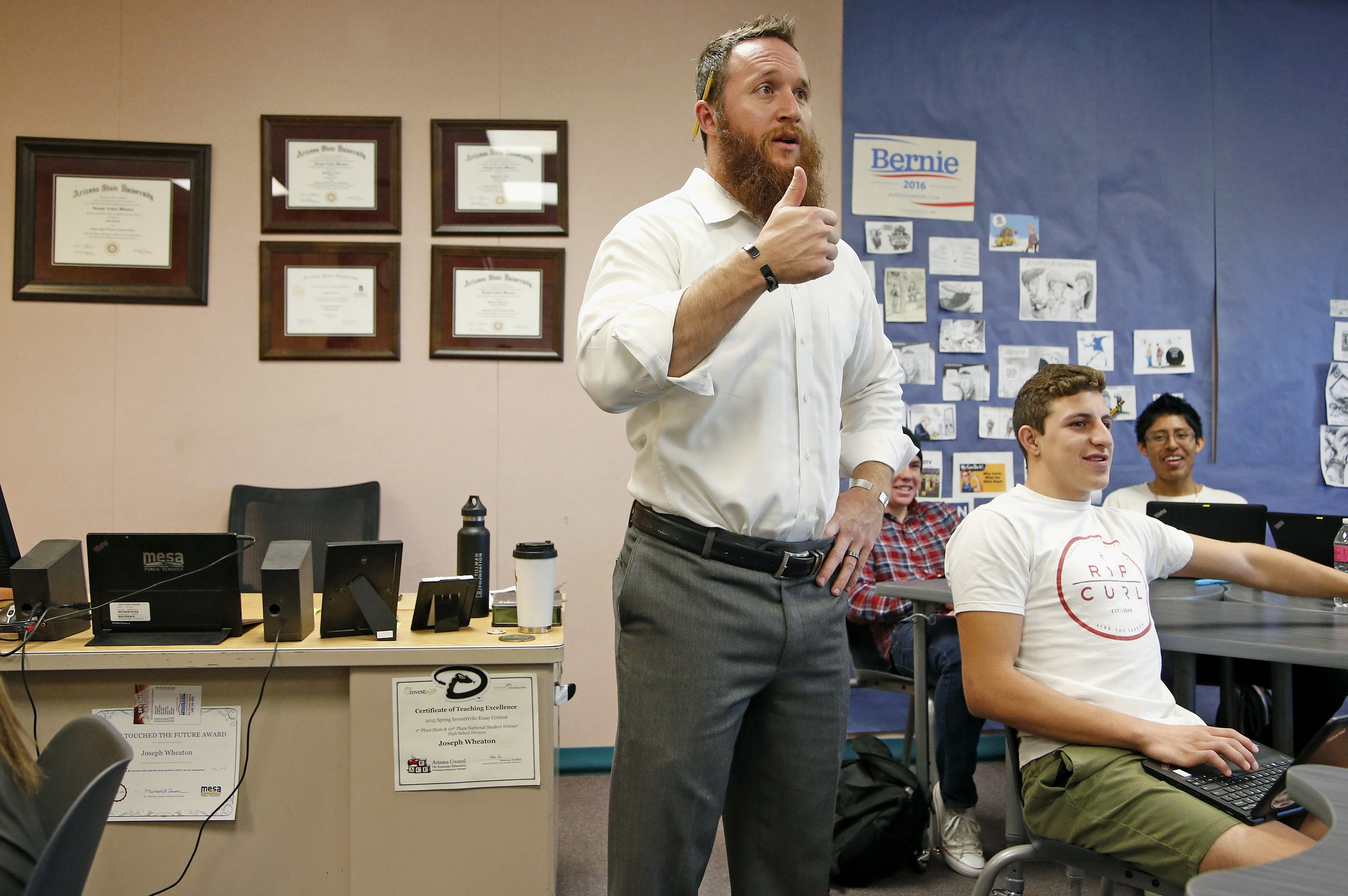 Joseph Wheaton, a teacher at Skyline High School, talks with his students Tuesday, Nov. 22, 2016, in Mesa, Ariz. Wheaton, a former U.S. Army Ranger, used a special scholarship by the Pat Tillman Foundation, the organization founded following the combat de