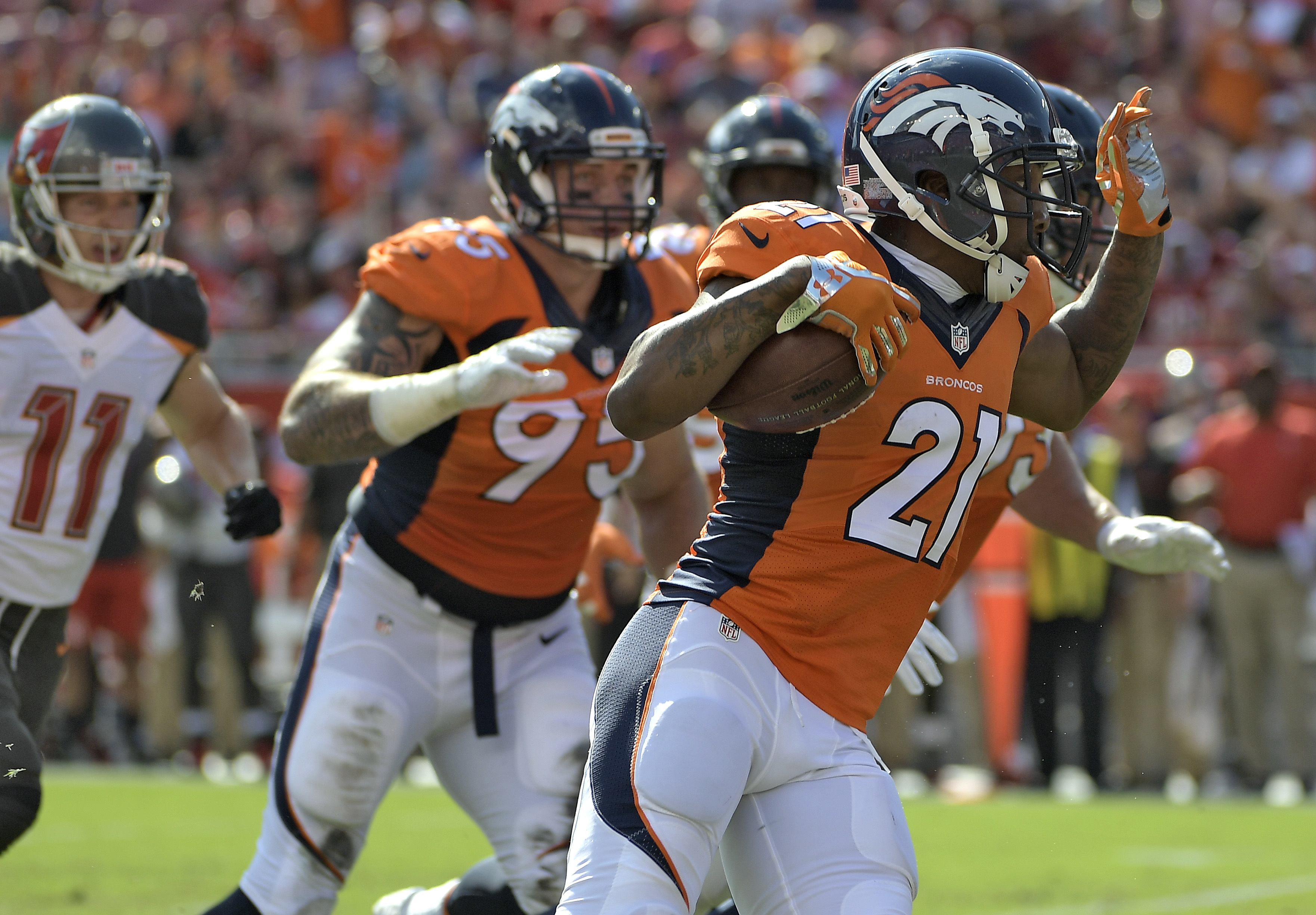 FILE - In a Sunday, Oct. 2, 2016 file photo, Denver Broncos cornerback Aqib Talib (21) runs with the football after intercepting a pass by Tampa Bay Buccaneers quarterback Jameis Winston during the first quarter of an NFL football game, in Tampa, Fla.  Co