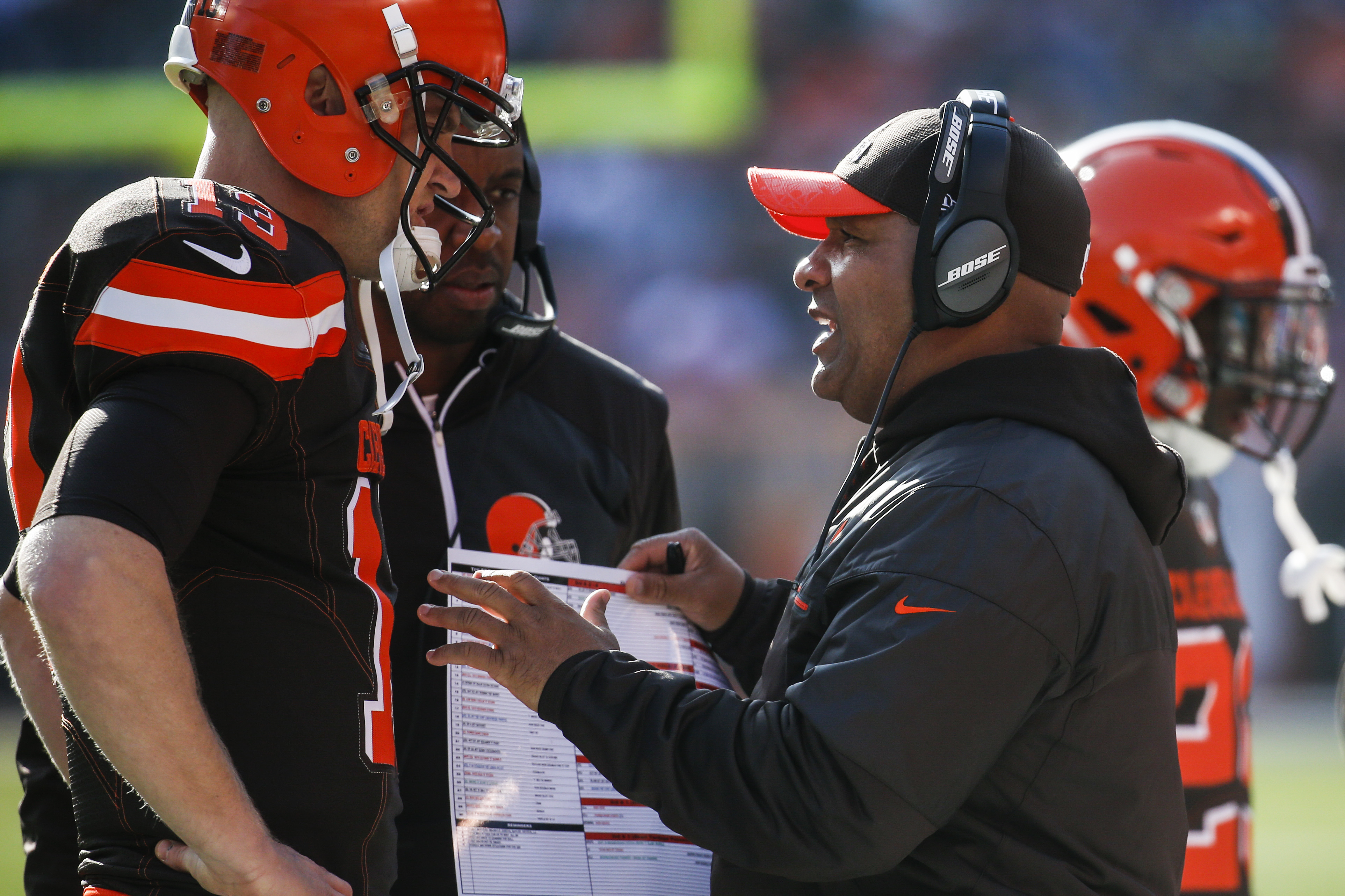 Cleveland Browns head coach Hue Jackson, right, meets with quarterback Josh McCown (13) on the sidelines in the first half of an NFL football game against the New York Giants, Sunday, Nov. 27, 2016, in Cleveland. (AP Photo/Ron Schwane)