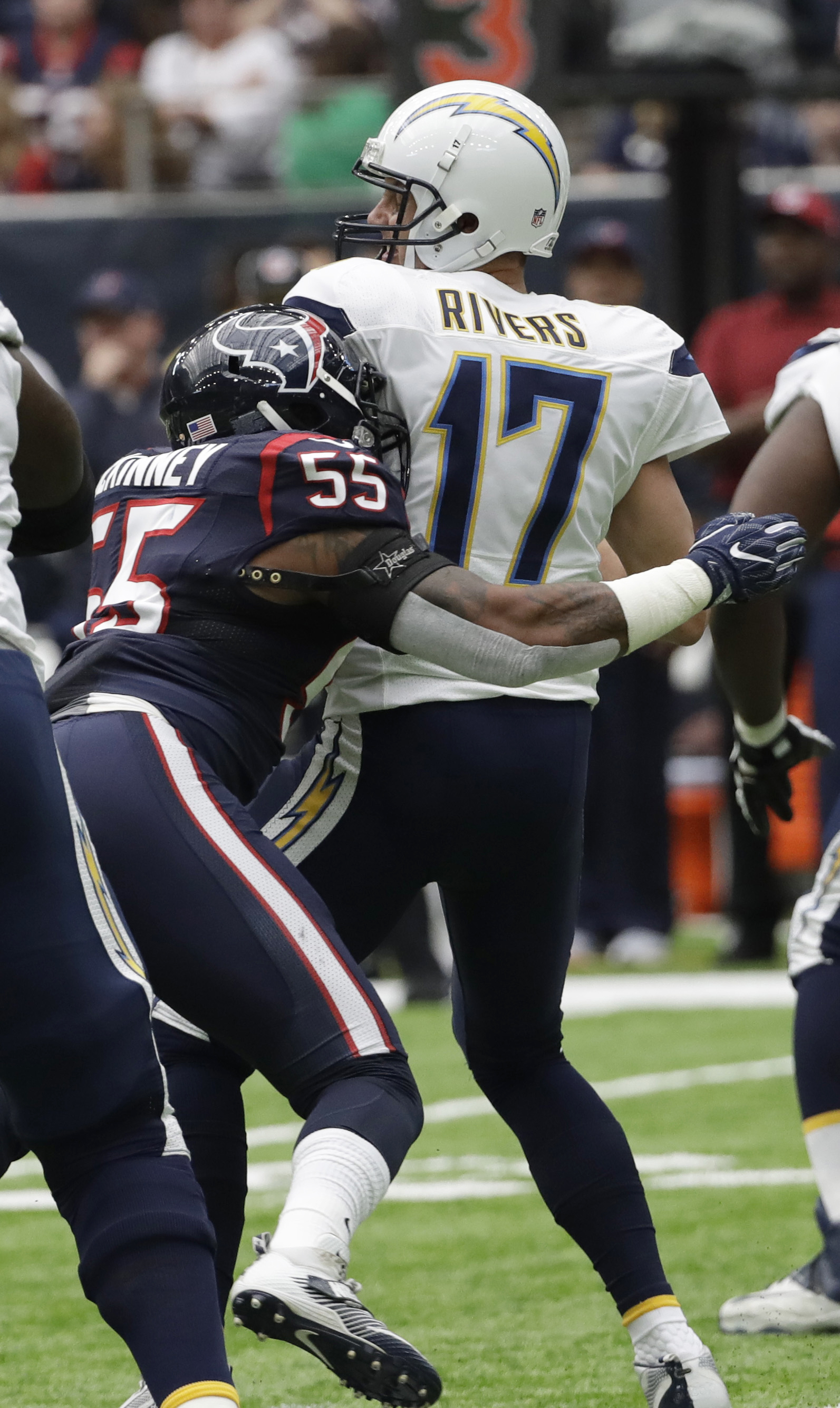 San Diego Chargers quarterback Philip Rivers is sacked by Houston Texans' Benardrick McKinney during the first half of an NFL football game Sunday, Nov. 27, 2016, in Houston. (AP Photo/David J. Phillip)