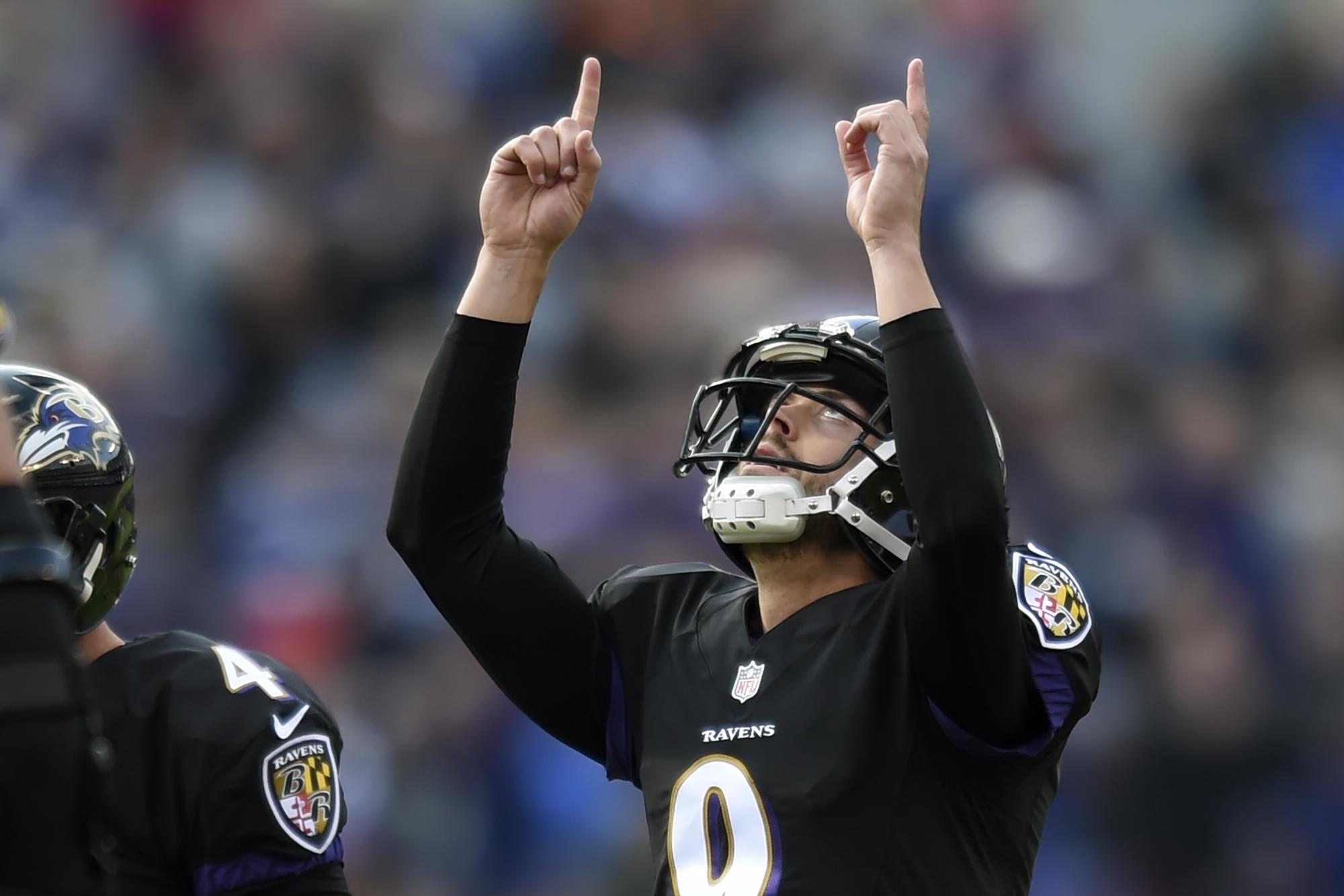 Baltimore Ravens kicker Justin Tucker (9) celebrates his field goal during the first half of an NFL football game against the Cincinnati Bengals in Baltimore, Sunday, Nov. 27, 2016. (AP Photo/Gail Burton)