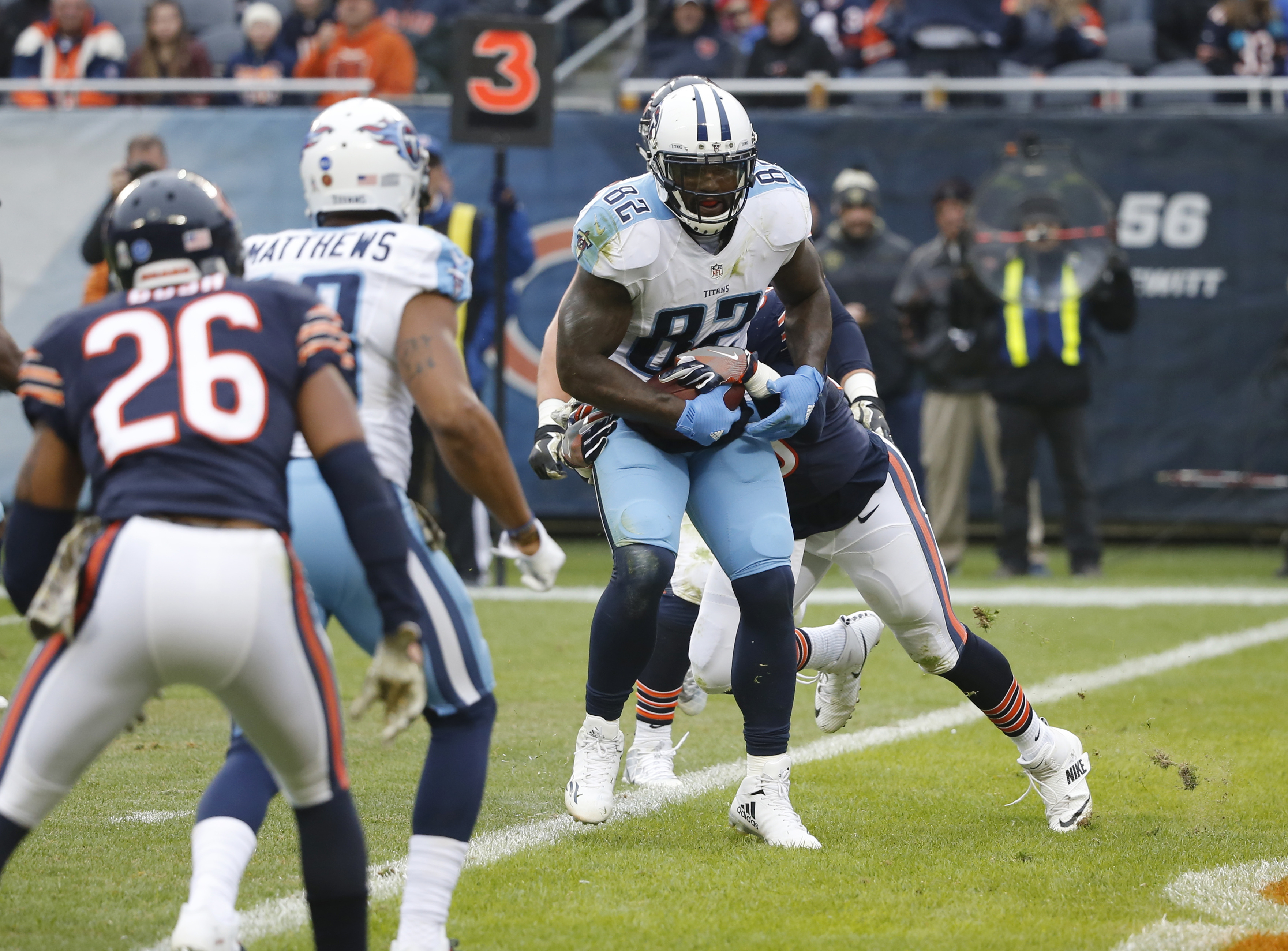 Tennessee Titans tight end Delanie Walker (82) runs to the end zone for touchdown against Chicago Bears inside linebacker Danny Trevathan (59) during the first half of an NFL football game, Sunday, Nov. 27, 2016, in Chicago. (AP Photo/Charles Rex Arbogast