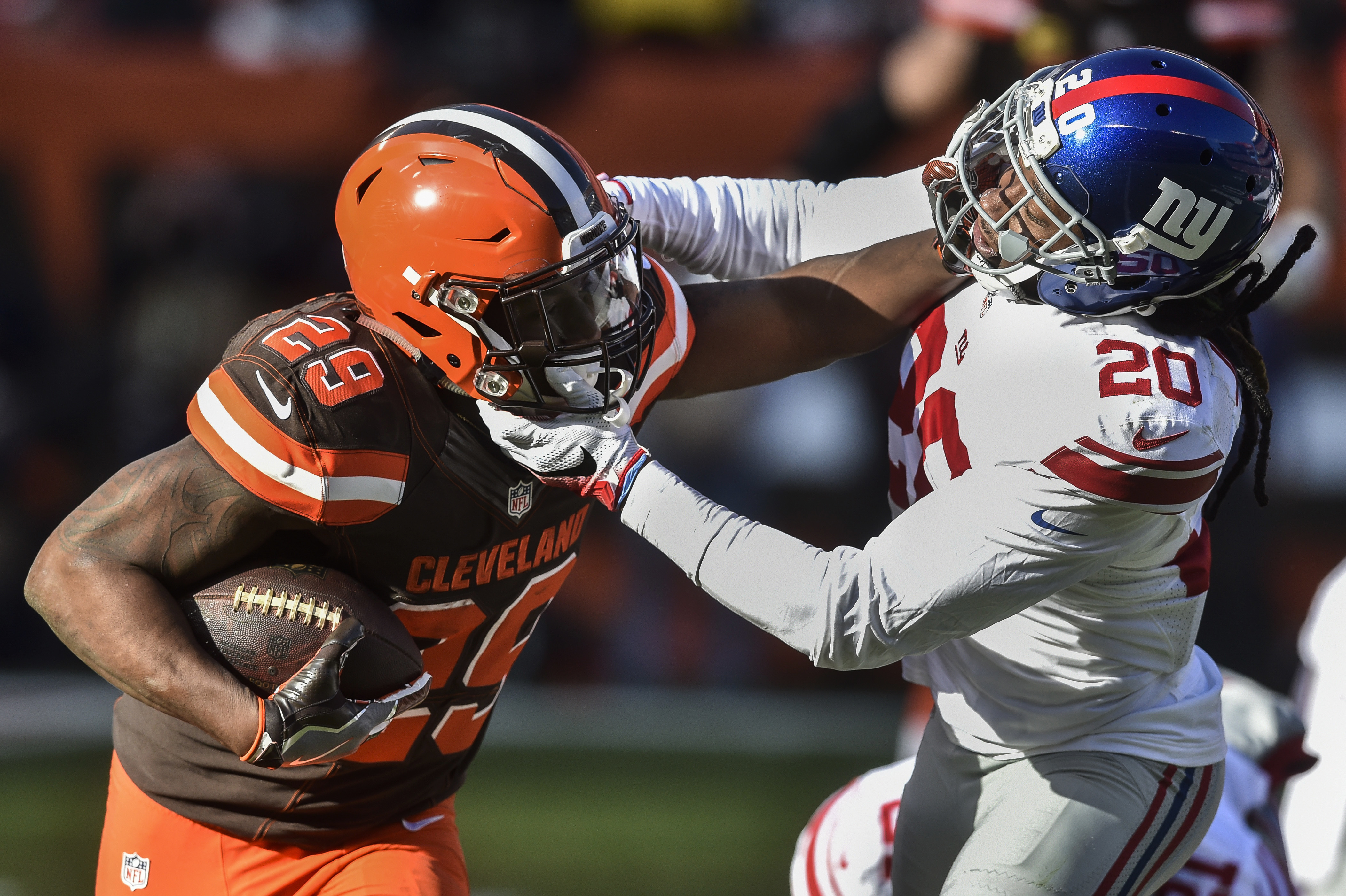 Cleveland Browns running back Duke Johnson (29) runs the ball against New York Giants cornerback Janoris Jenkins (20) in the first half of an NFL football game, Sunday, Nov. 27, 2016, in Cleveland. (AP Photo/David Richard)