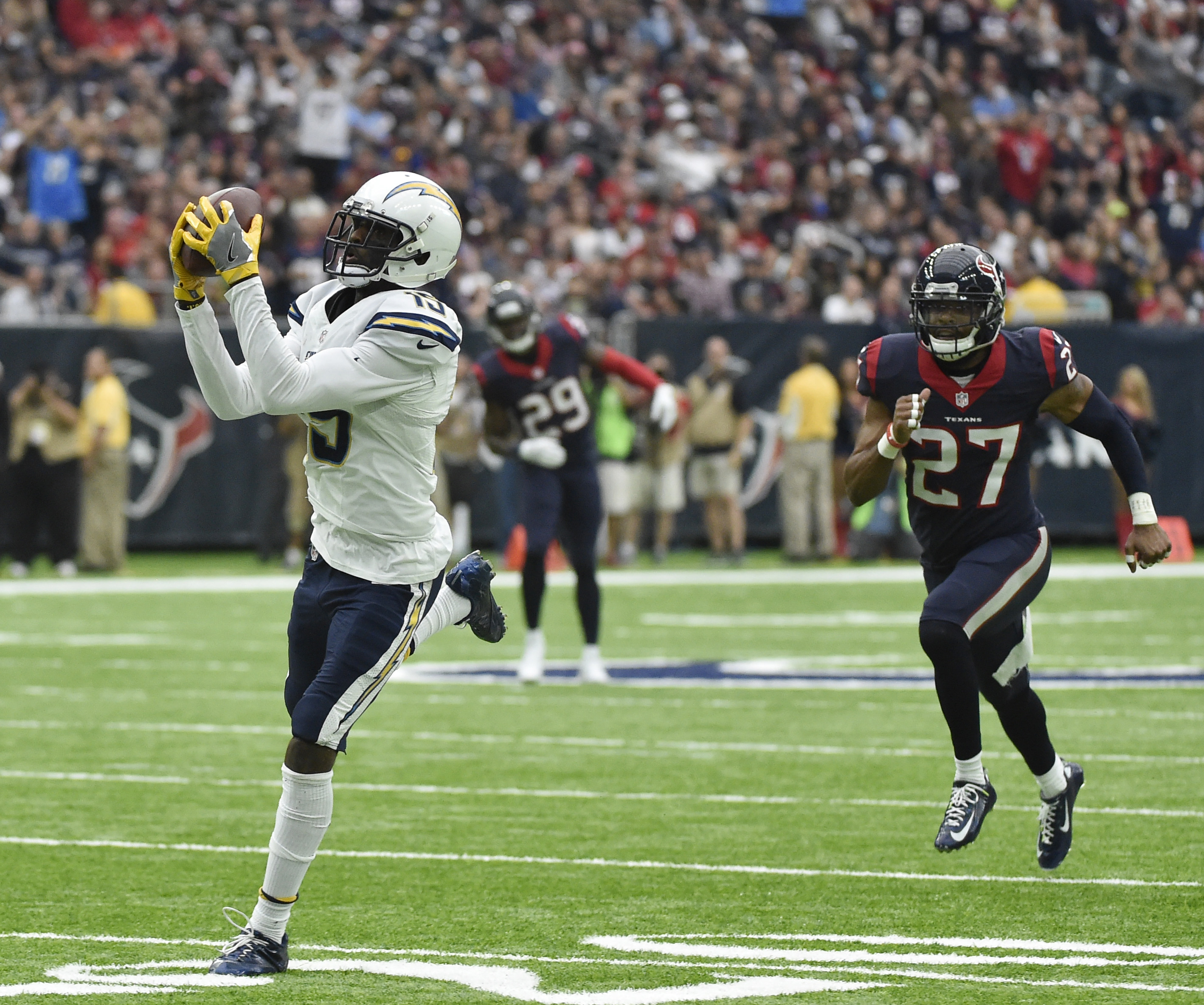 San Diego Chargers' Dontrelle Inman pulls in a pass in front of Houston Texans' Quintin Demps on his way to a 52-yard touchdown play during the first half of an NFL football game, Sunday, Nov. 27, 2016, in Houston. (AP Photo/Eric Christian Smith)