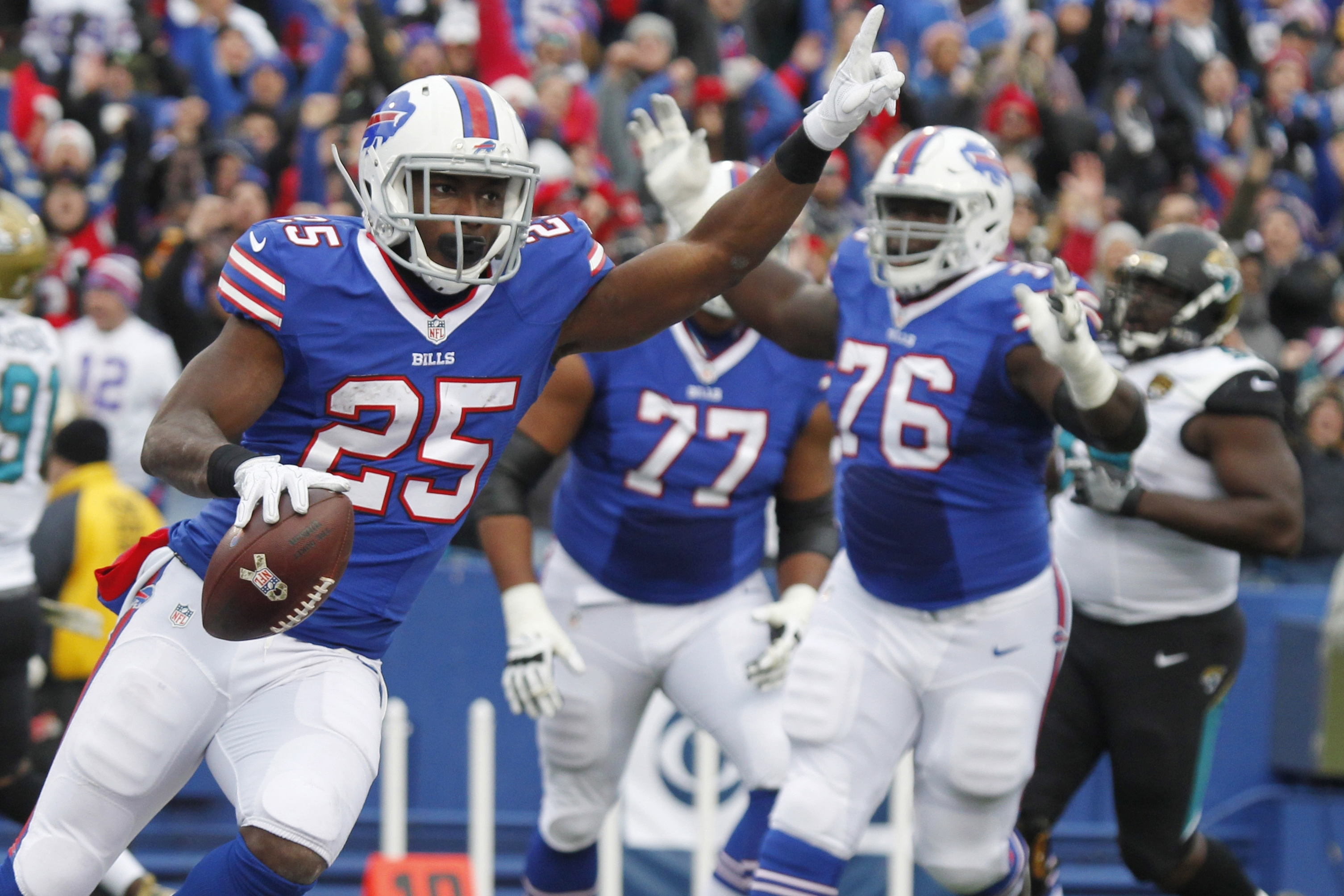 Buffalo Bills running back LeSean McCoy (25) celebrates after rushing for a touchdown during the first half of an NFL football game against the Jacksonville Jaguars on Sunday, Nov. 27, 2016, in Orchard Park, N.Y. (AP Photo/Jeffrey T. Barnes)