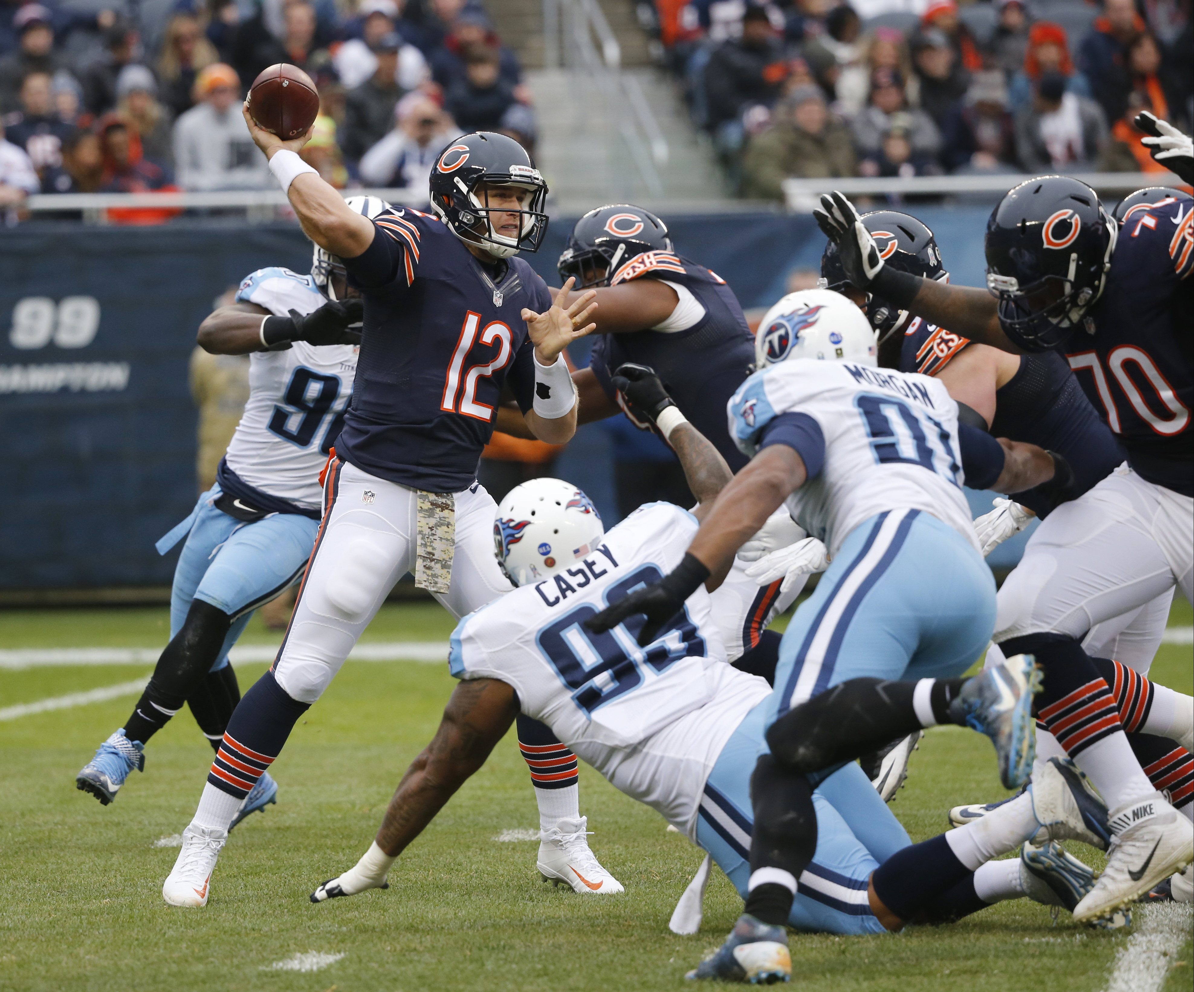 Chicago Bears quarterback Matt Barkley (12) throws a pass under pressure during the first half of an NFL football game against the Tennessee Titans, Sunday, Nov. 27, 2016, in Chicago. (AP Photo/Charles Rex Arbogast)
