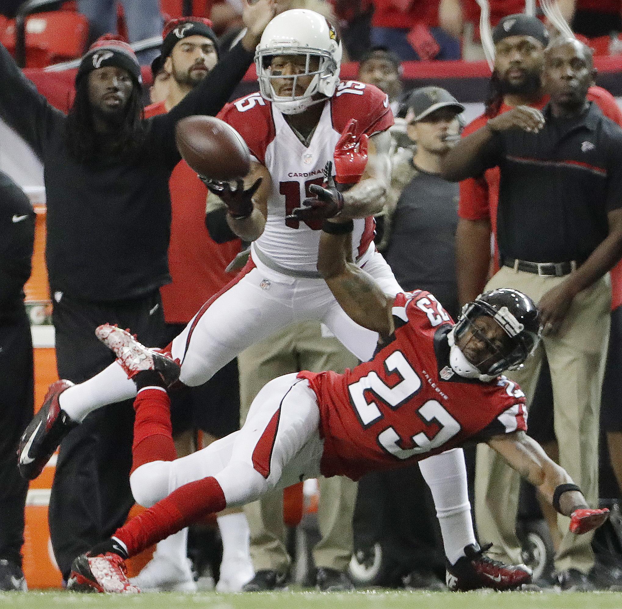 Arizona Cardinals wide receiver Michael Floyd (15) misses the catch against Atlanta Falcons cornerback Robert Alford (23) during the second of an NFL football game, Sunday, Nov. 27, 2016, in Atlanta. (AP Photo/David Goldman)