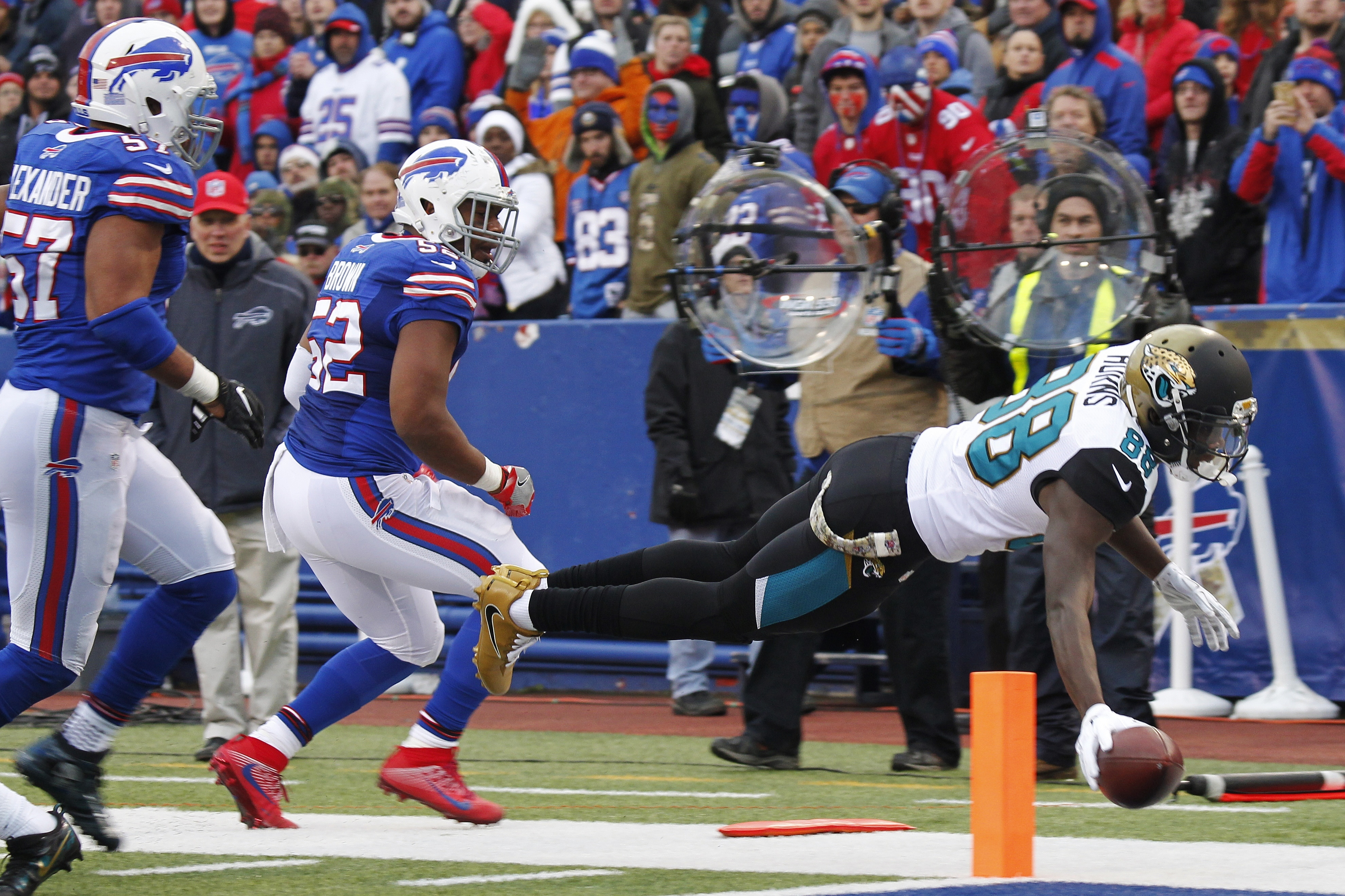 Jacksonville Jaguars wide receiver Allen Hurns (88) dives into the end zone as Buffalo Bills' Preston Brown (52) and Lorenzo Alexander (57) watch him during the second half of an NFL football game, Sunday, Nov. 27, 2016, in Orchard Park, N.Y. (AP Photo/Je