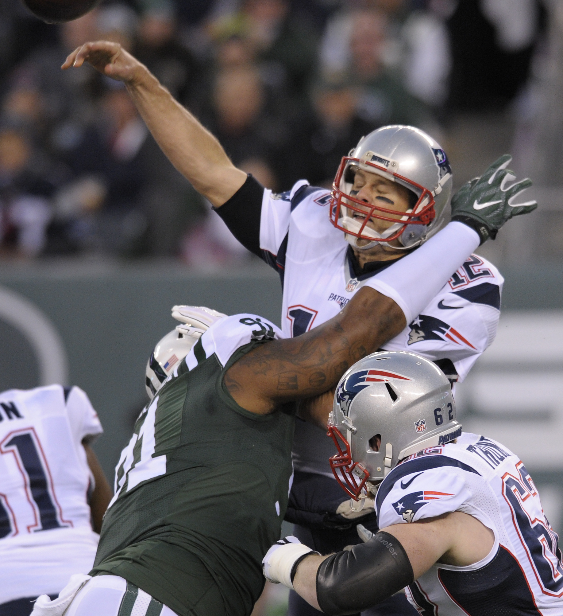 New England Patriots quarterback Tom Brady (12) throws under pressure from New York Jets defensive end Sheldon Richardson (91) during the first quarter of anNFL football game, Sunday, Nov. 27, 2016, in East Rutherford, N.J. (AP Photo/Bill Kostroun)