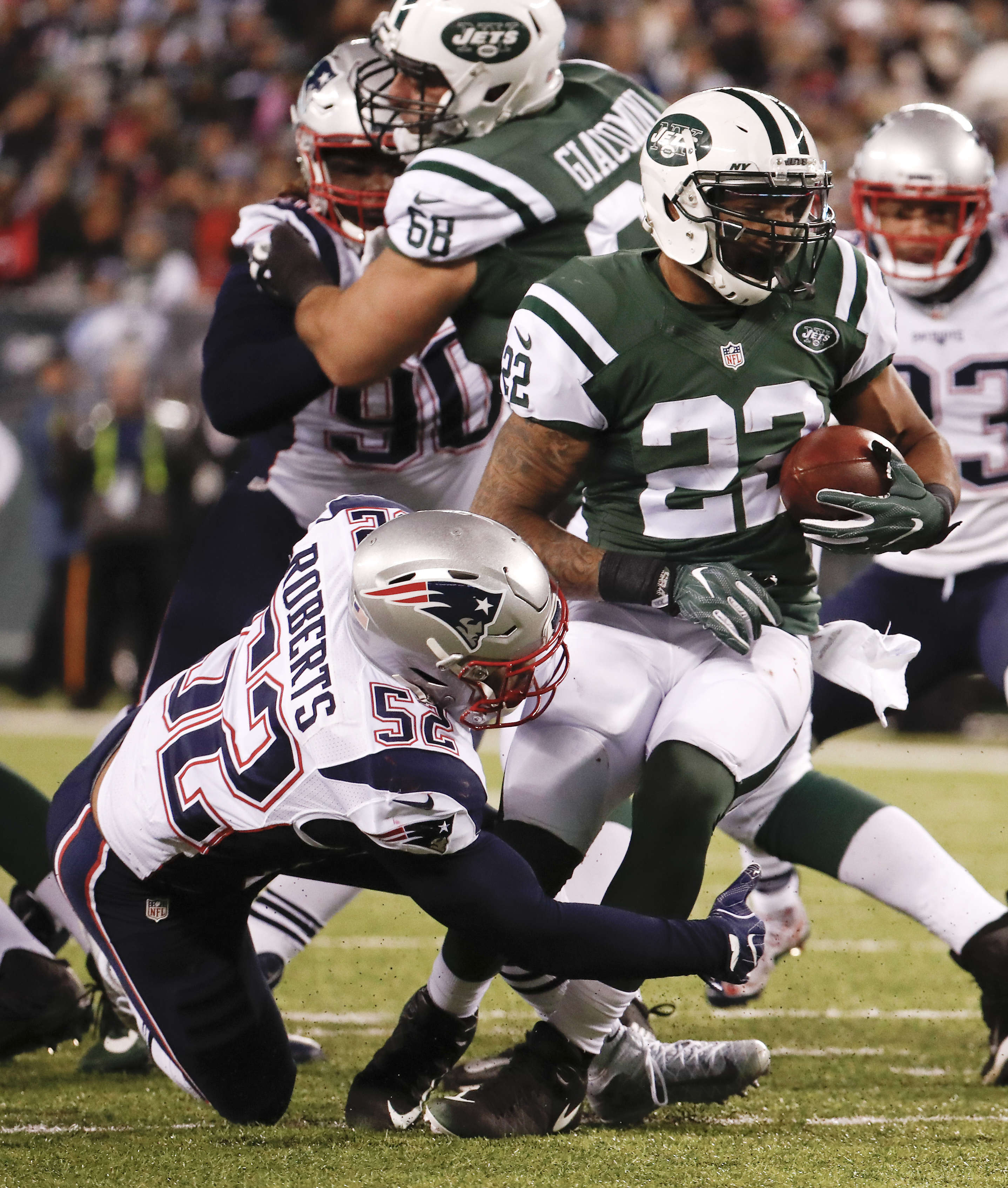 New York Jets running back Matt Forte (22) is tackled by New York Jets middle linebacker David Harris (52) during the first quarter of an NFL football game, Sunday, Nov. 27, 2016, in East Rutherford, N.J. (AP Photo/Julio Cortez)