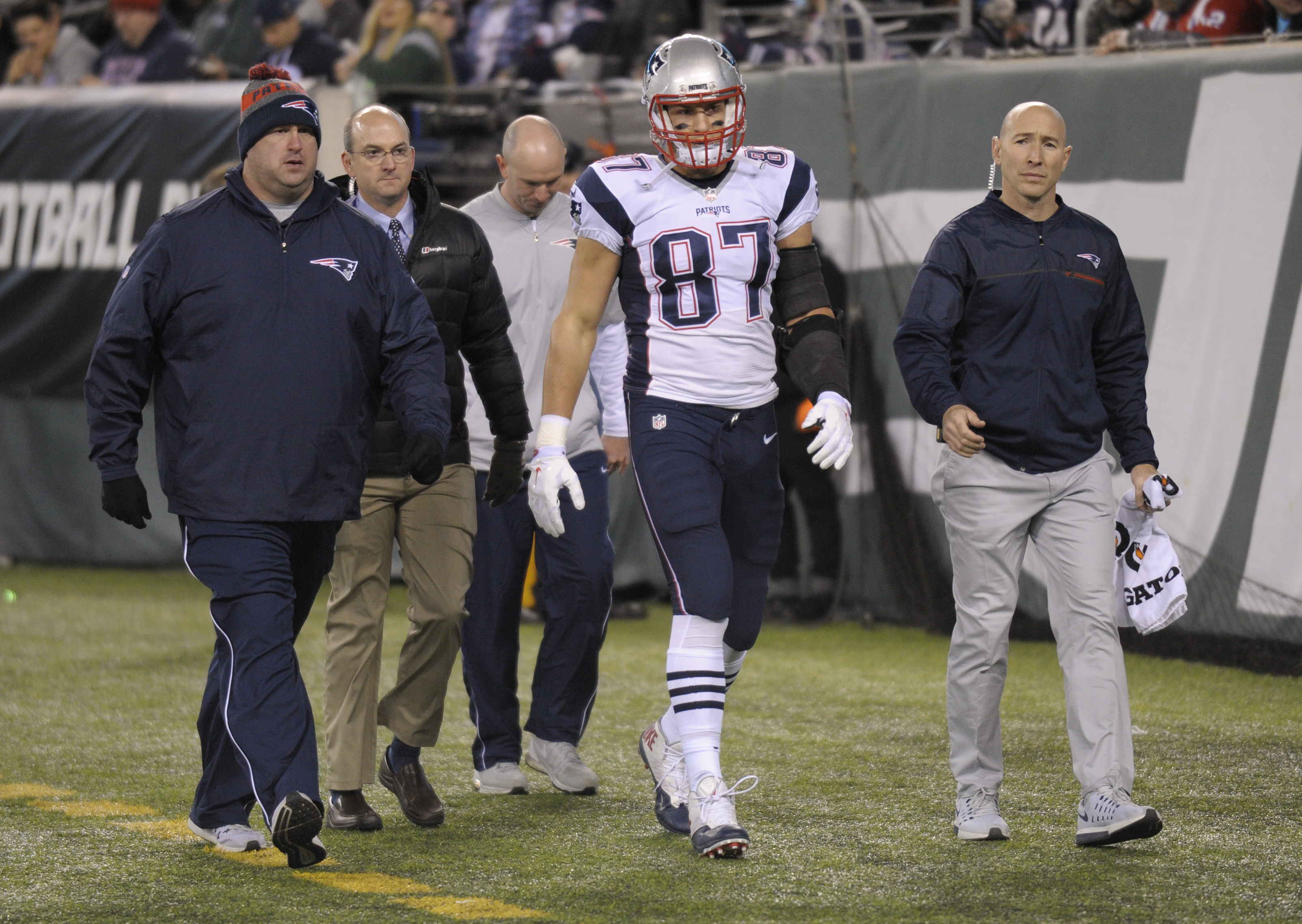 New England Patriots tight end Rob Gronkowski (87) walks off the field with an injury during the second quarter of an NFL football game against the New York Jets, Sunday, Nov. 27, 2016, in East Rutherford, N.J. (AP Photo/Bill Kostroun)