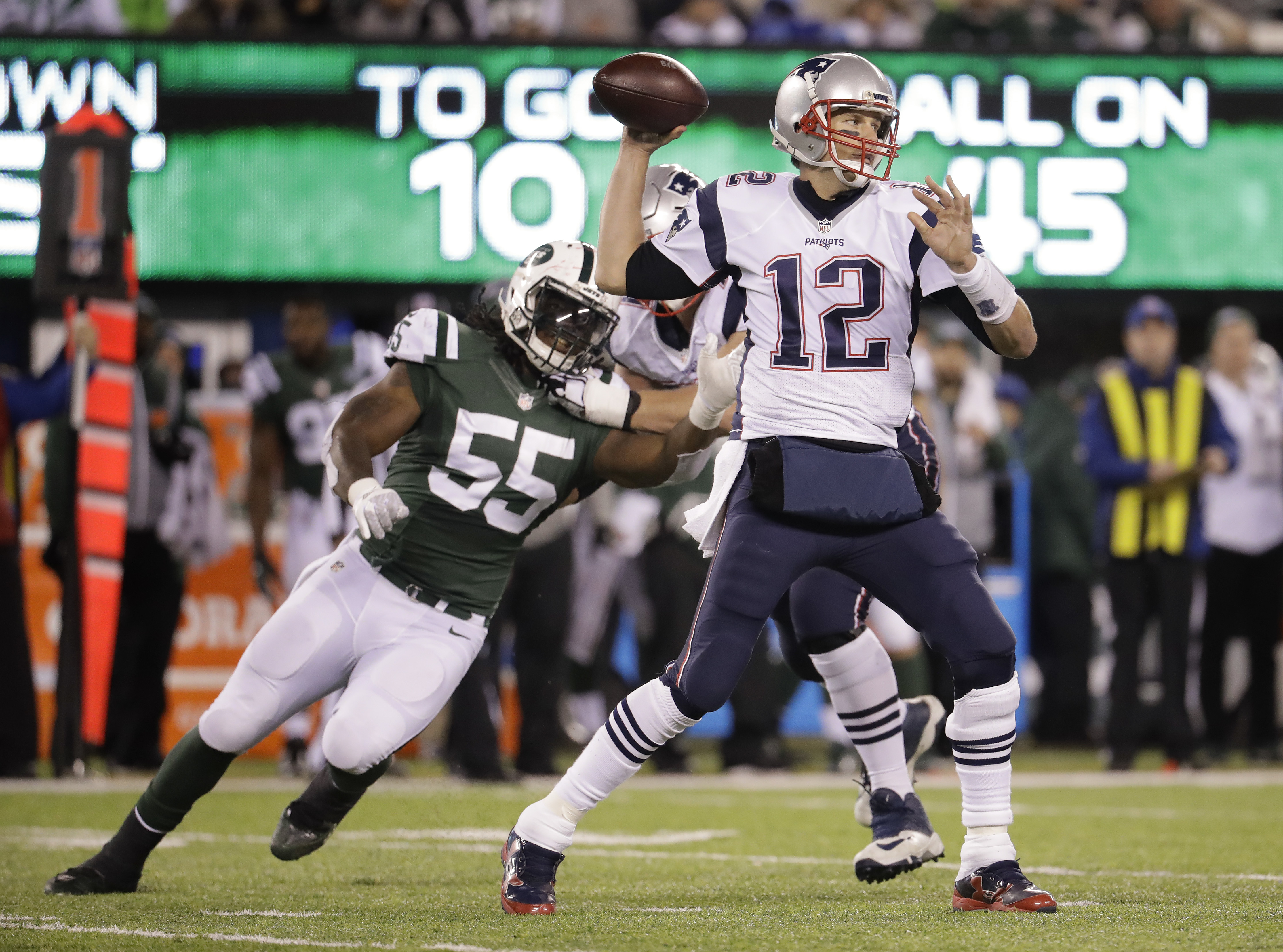 New England Patriots quarterback Tom Brady (12) throws under pressure from New York Jets outside linebacker Lorenzo Mauldin (55) during the third quarter of an NFL football game, Sunday, Nov. 27, 2016, in East Rutherford, N.J. (AP Photo/Julio Cortez)