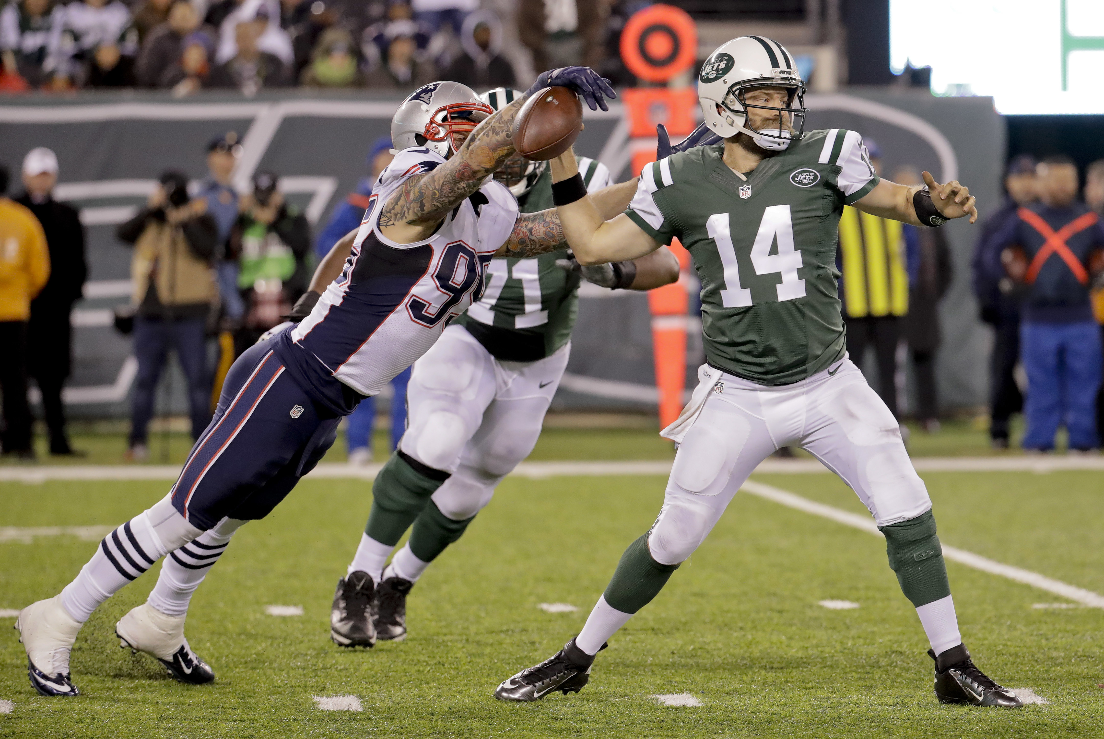 New England Patriots defensive end Chris Long (95) gets a hand on the ball as New York Jets quarterback Ryan Fitzpatrick (14) throws during the fourth quarter of an NFL football game, Sunday, Nov. 27, 2016, in East Rutherford, N.J. The Patriots recovered