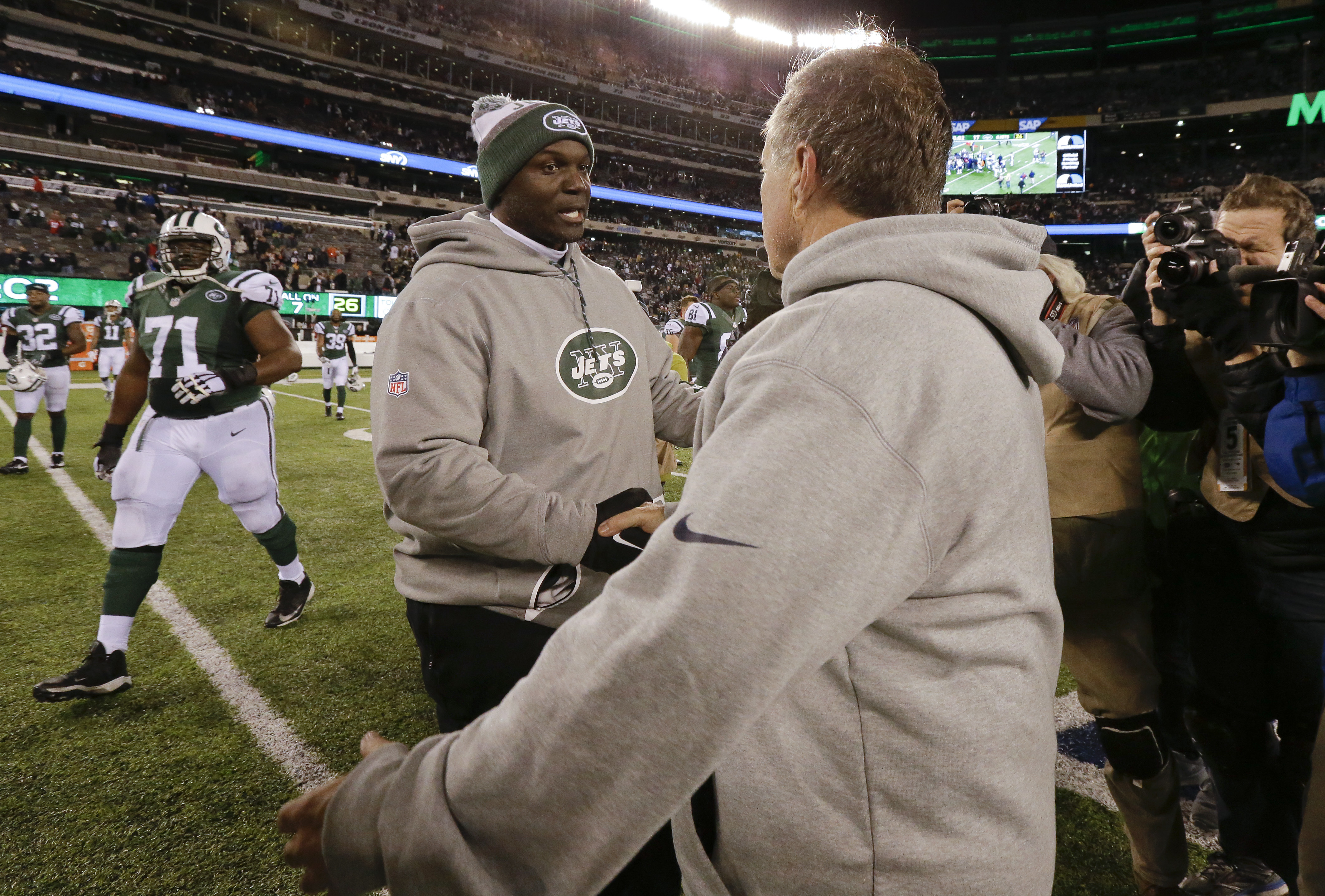 New York Jets head coach Todd Bowles, left, and New England Patriots head coach Bill Belichick meet at midfield after an NFL football game, Sunday, Nov. 27, 2016, in East Rutherford, N.J. The Patriots won 22-17. (AP Photo/Julio Cortez)