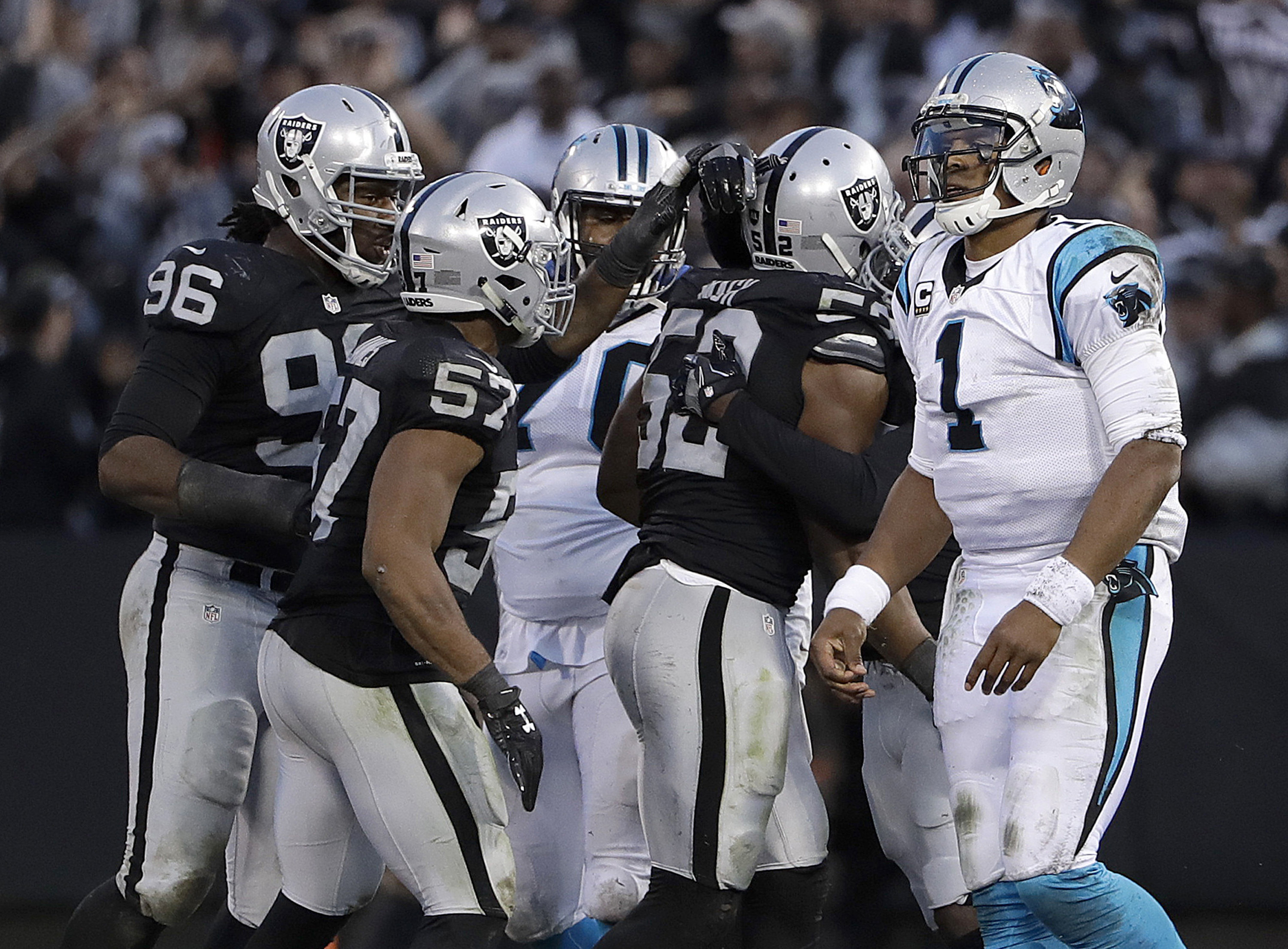 Oakland Raiders defensive end Khalil Mack (52) celebrates with teammates after recovering a fumble by Carolina Panthers quarterback Cam Newton (1) during the second half of an NFL football game in Oakland, Calif., Sunday, Nov. 27, 2016. The Raiders won 35
