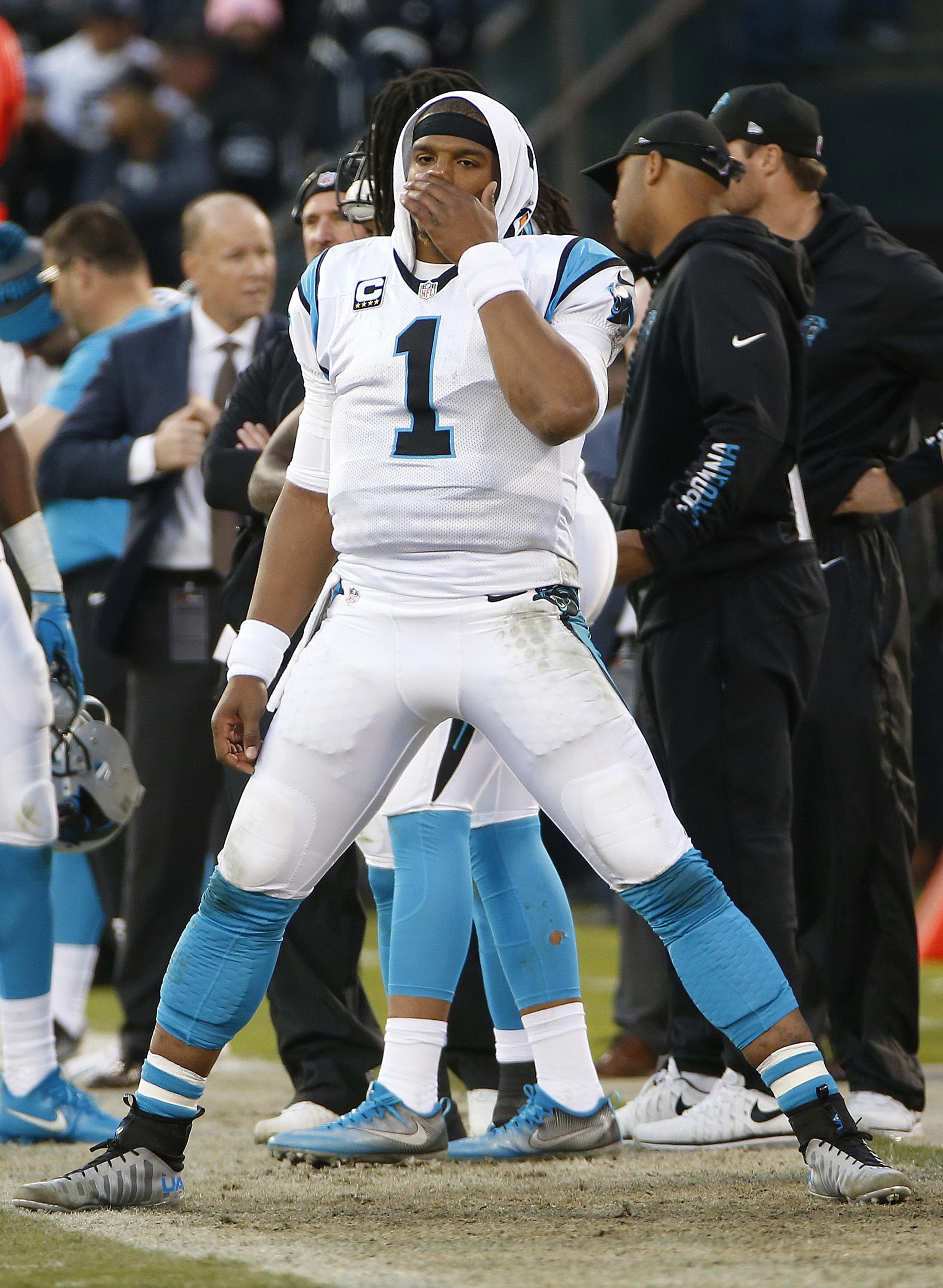 Carolina Panthers quarterback Cam Newton (1) watches on the sideline during the second half of an NFL football game against the Oakland Raiders in Oakland, Calif., Sunday, Nov. 27, 2016. The Raiders won 35-32. (AP Photo/Tony Avelar)