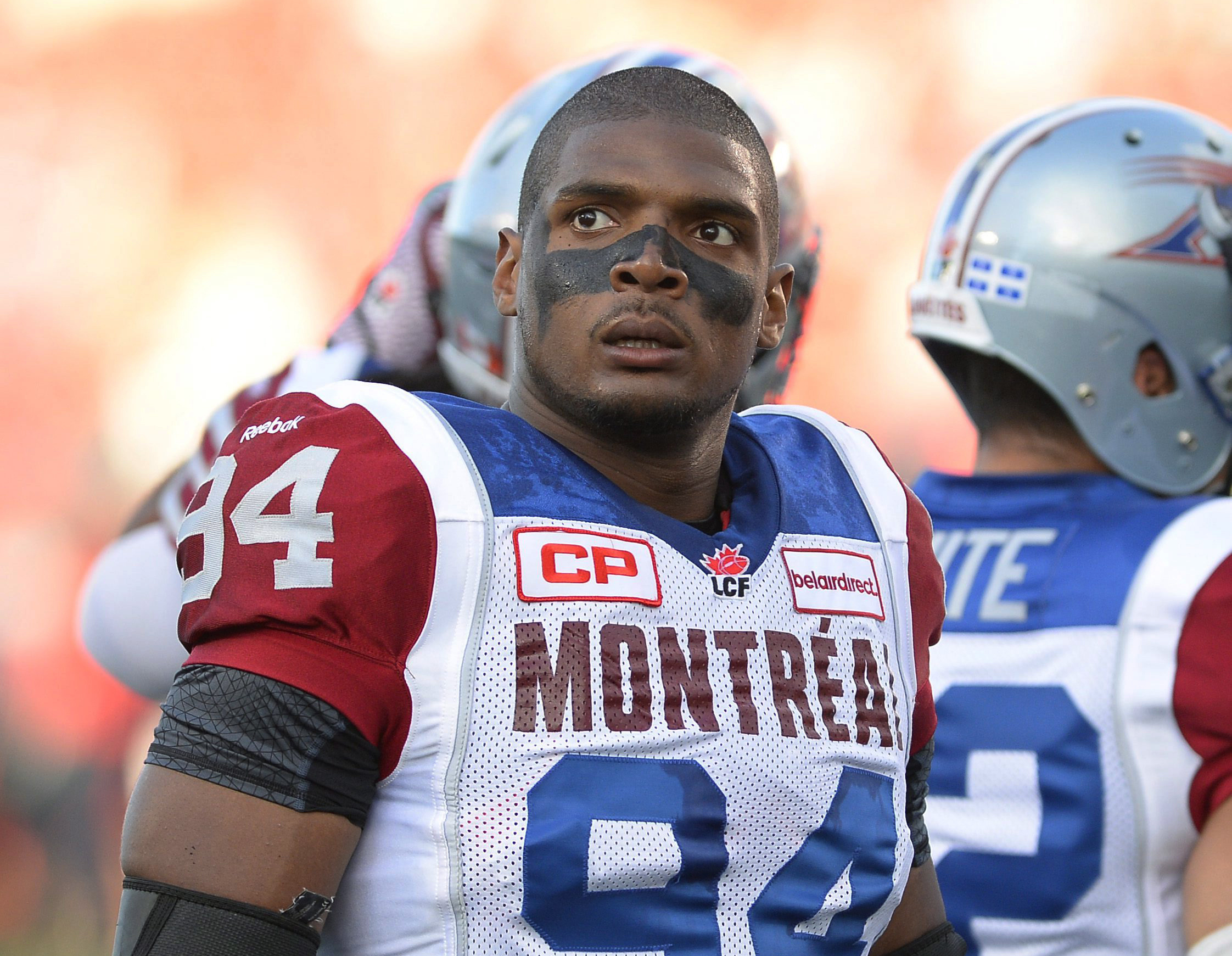 FILE - In this Aug. 7, 2014, file photo, Montreal Alouettes' Michael Sam and teammates warm up for a Canadian Football League game against the Ottawa Redblacks in Ottawa, Ontario. The first openly gay player to be drafted by an NFL team is heading to Mass