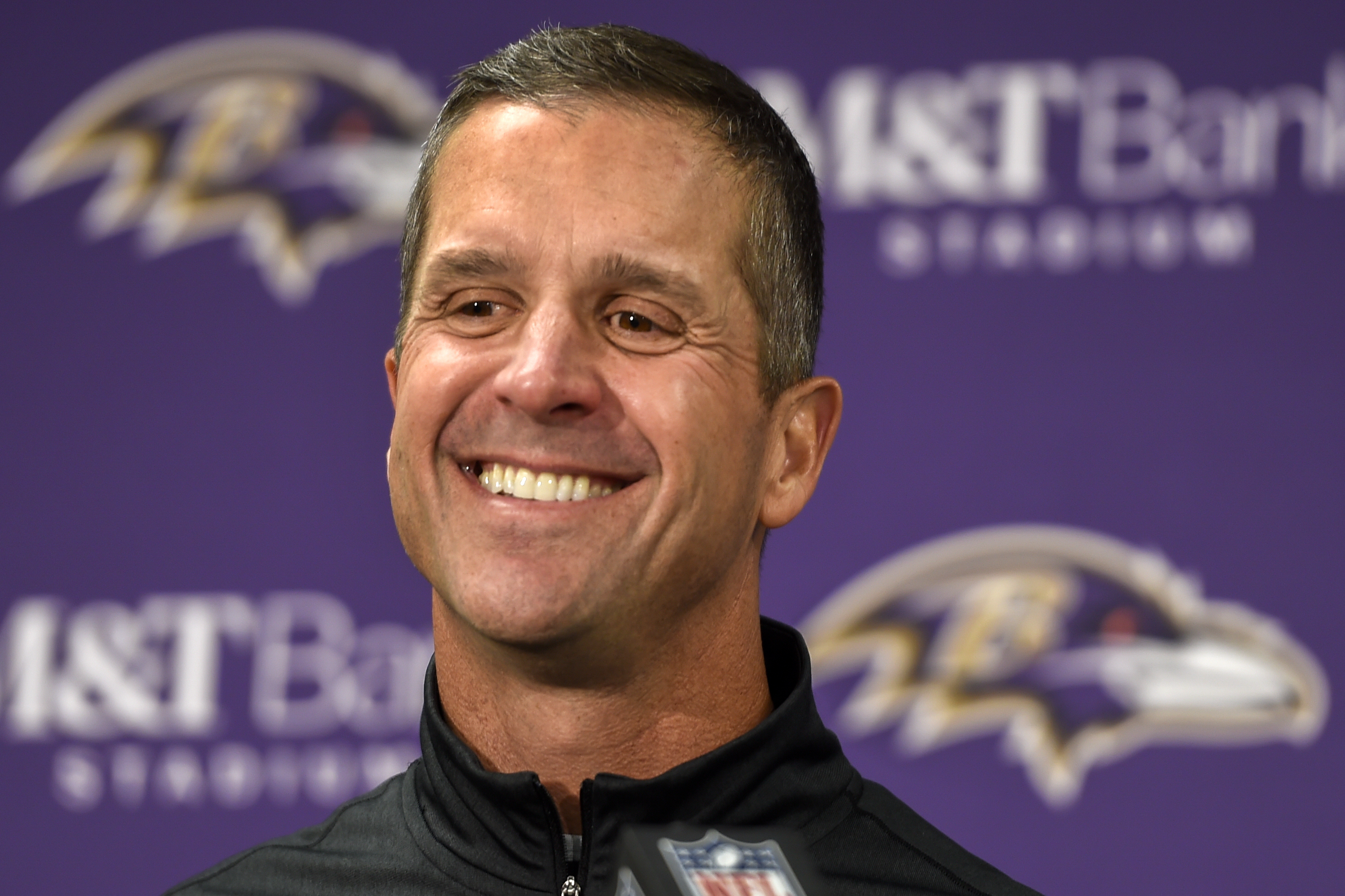 FILE - In this Sunday, Nov. 27, 2016, file photo, Baltimore Ravens head coach John Harbaugh answers a question during a post game press conference after defeating the Cincinnati Bengals 19-14, in Baltimore. With Baltimore leading Cincinnati by seven point