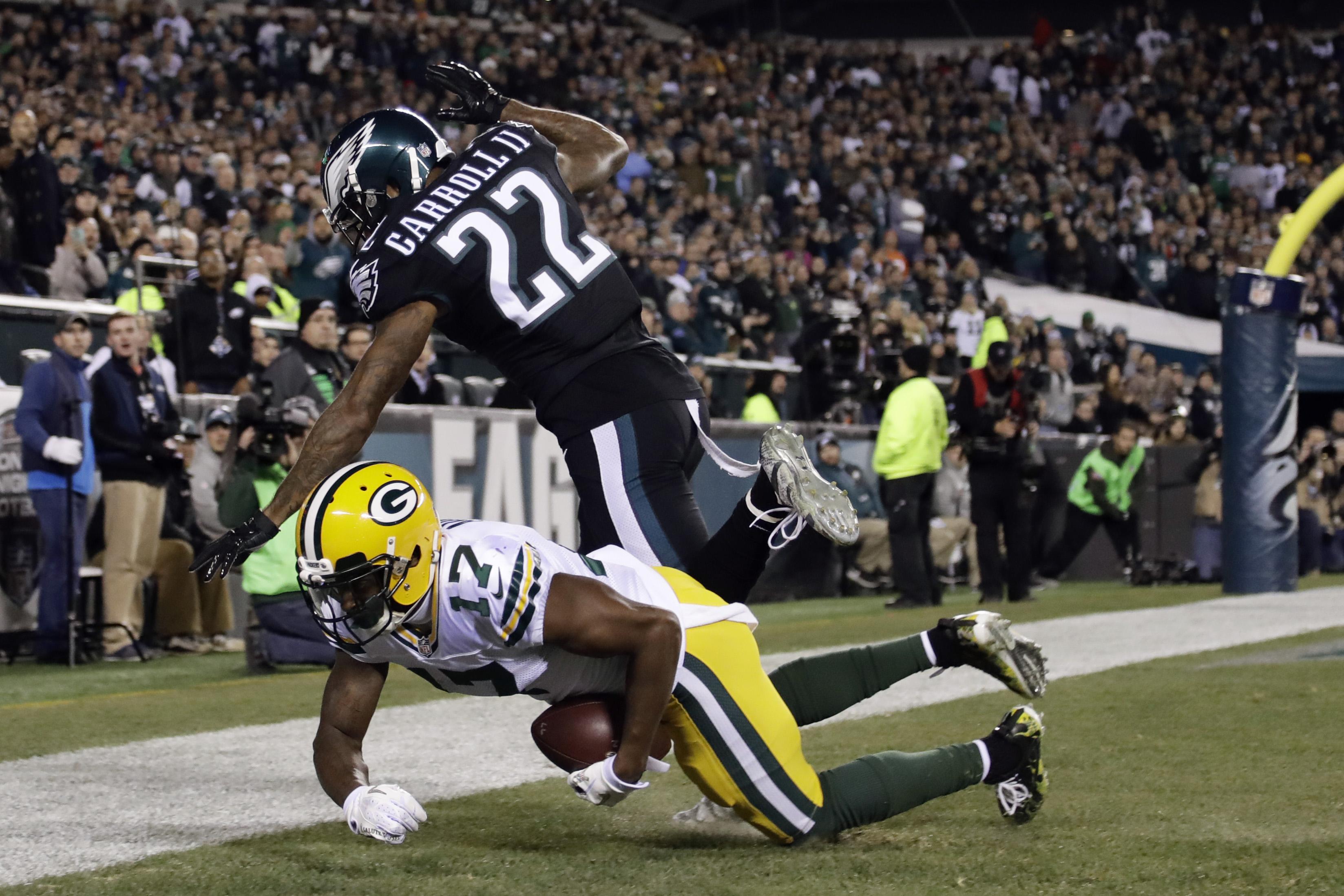 Green Bay Packers' Trevor Davis (11) scores a touchdown against Philadelphia Eagles' Nolan Carroll (22) during the first half of an NFL football game, Monday, Nov. 28, 2016, in Philadelphia. (AP Photo/Matt Rourke)