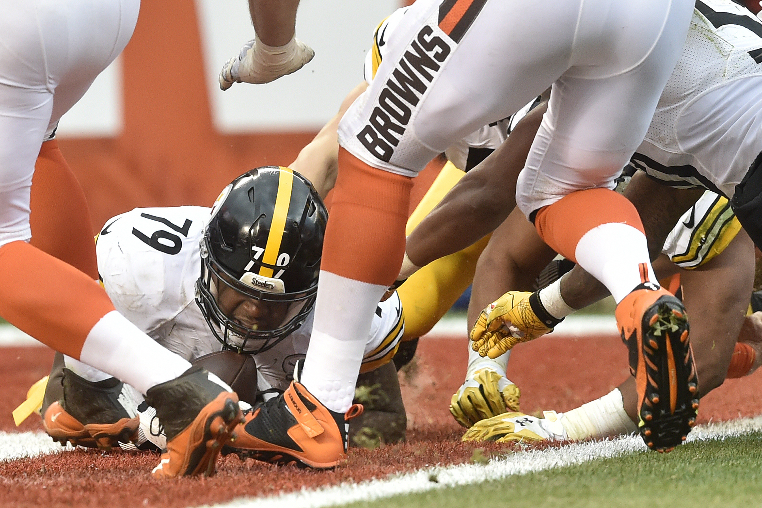 FILE - In this Nov. 20, 2016, file photo, Pittsburgh Steelers nose tackle Javon Hargrave (79) falls on a fumble by Cleveland Browns quarterback Josh McCown (13) in the end zone for a touchdown during the second half of an NFL football game in Cleveland. T