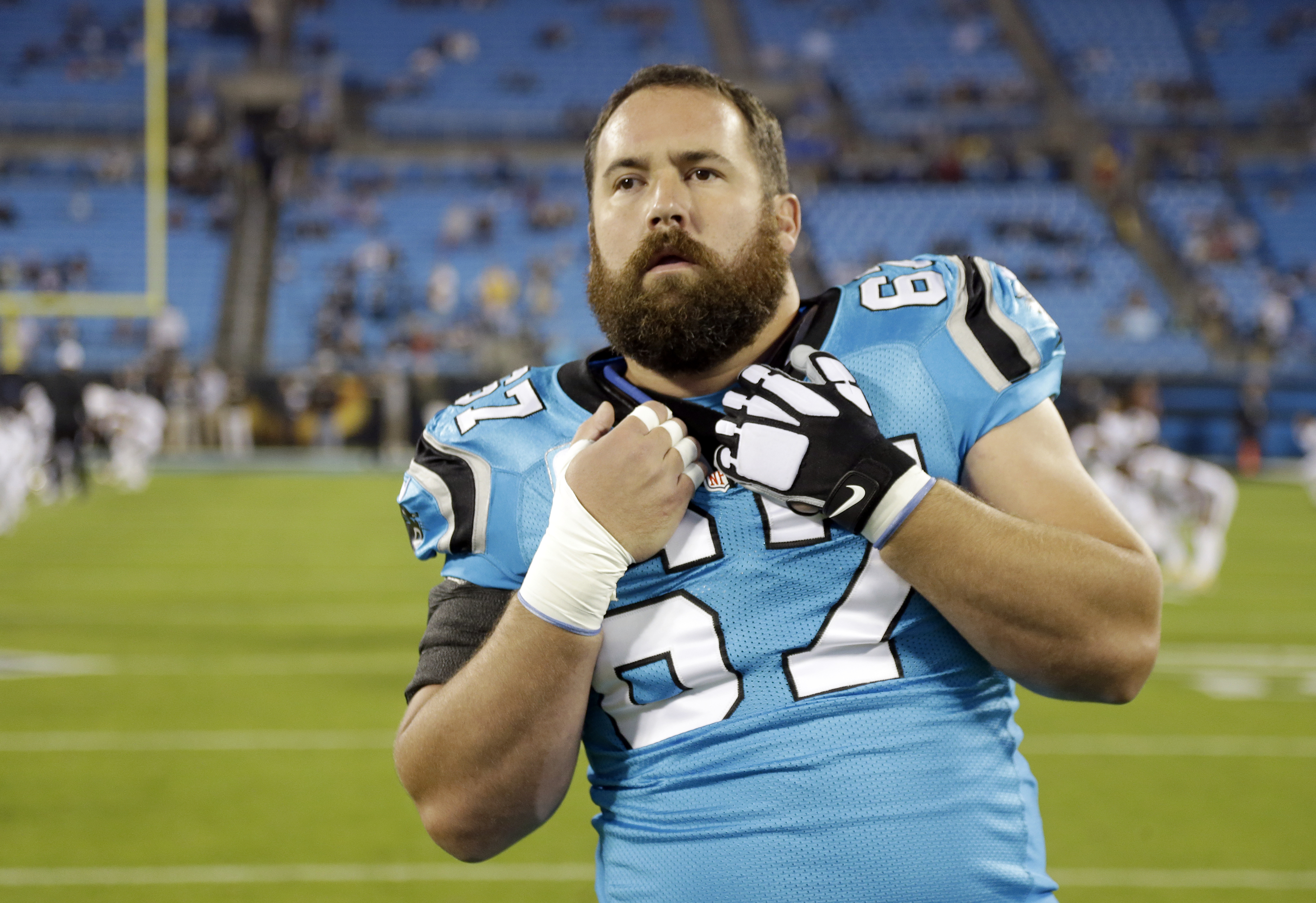 Carolina Panthers' Ryan Kalil (67) stretches before an NFL football game against the New Orleans Saints in Charlotte, N.C., Thursday, Nov. 17, 2016. The Panthers won 23-20.(AP Photo/Bob Leverone)