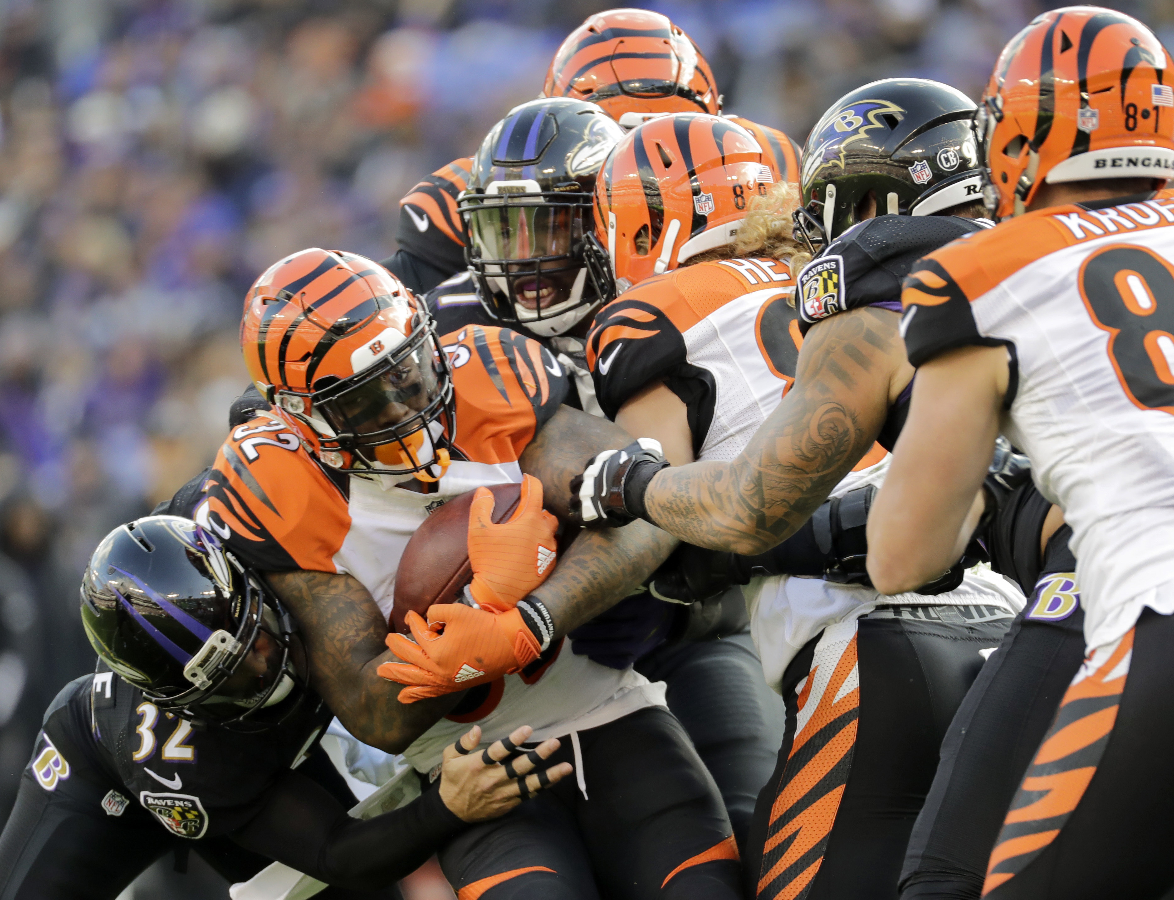 FILE - In this Sunday, Nov. 27, 2016, file photo, Cincinnati Bengals running back Jeremy Hill (32) is stopped by the Baltimore Ravens defense during the first half of an NFL football game in Baltimore.  All the Bengals running backs could manage was 50 ya