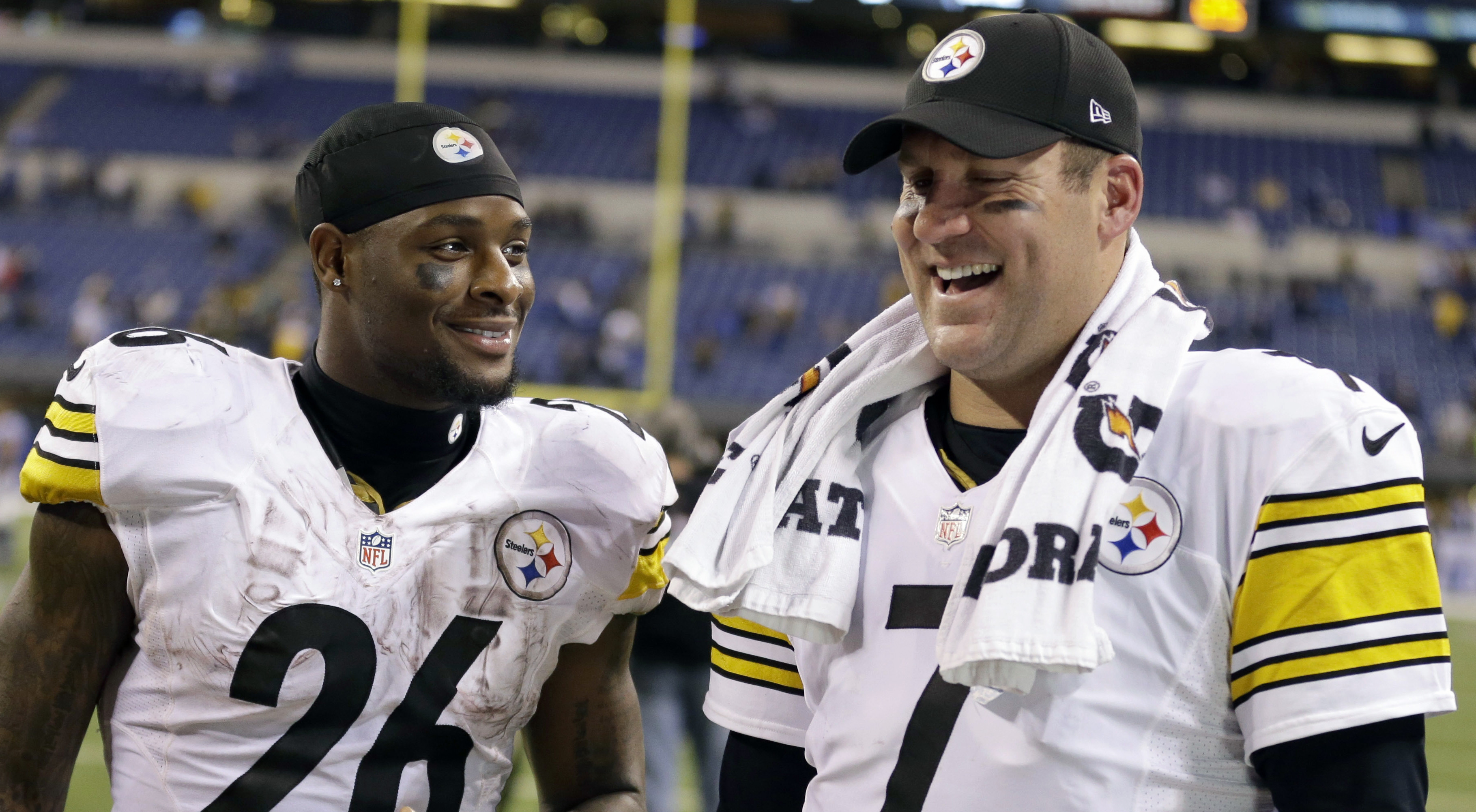 FILE - In this Nov. 24, 2016, file photo, Pittsburgh Steelers quarterback Ben Roethlisberger (7) and running back Le'Veon Bell (26) talk following an NFL football game against the Indianapolis Colts, in Indianapolis. Four years in, Roethlisberger is still