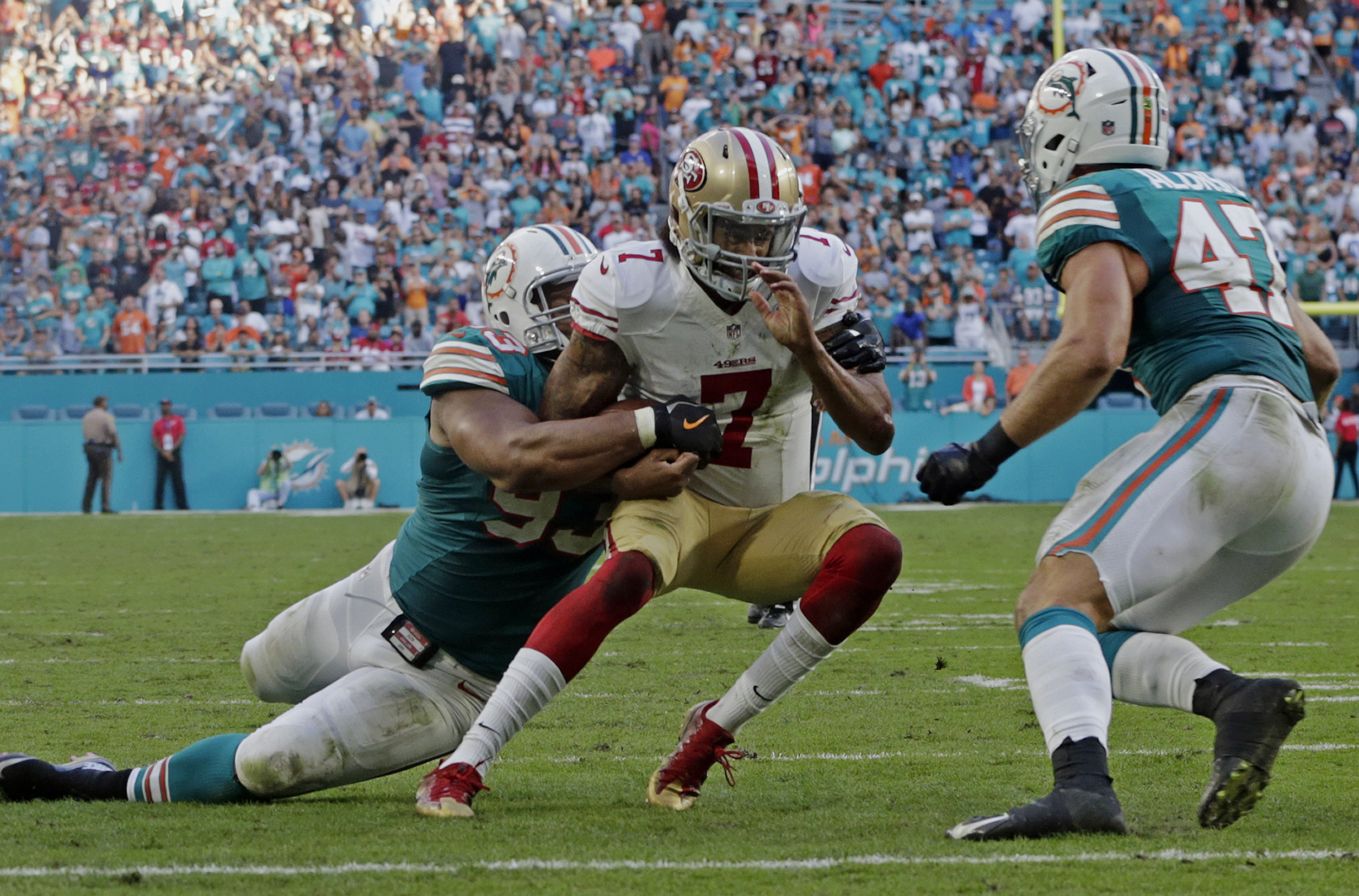 FILE - In this Sunday, Nov. 27, 2016, file photo, San Francisco 49ers quarterback Colin Kaepernick (7) is tackled by Miami Dolphins defensive tackle Ndamukong Suh (93) near the end zone, during the second half of an NFL football game, in Miami Gardens, Fl