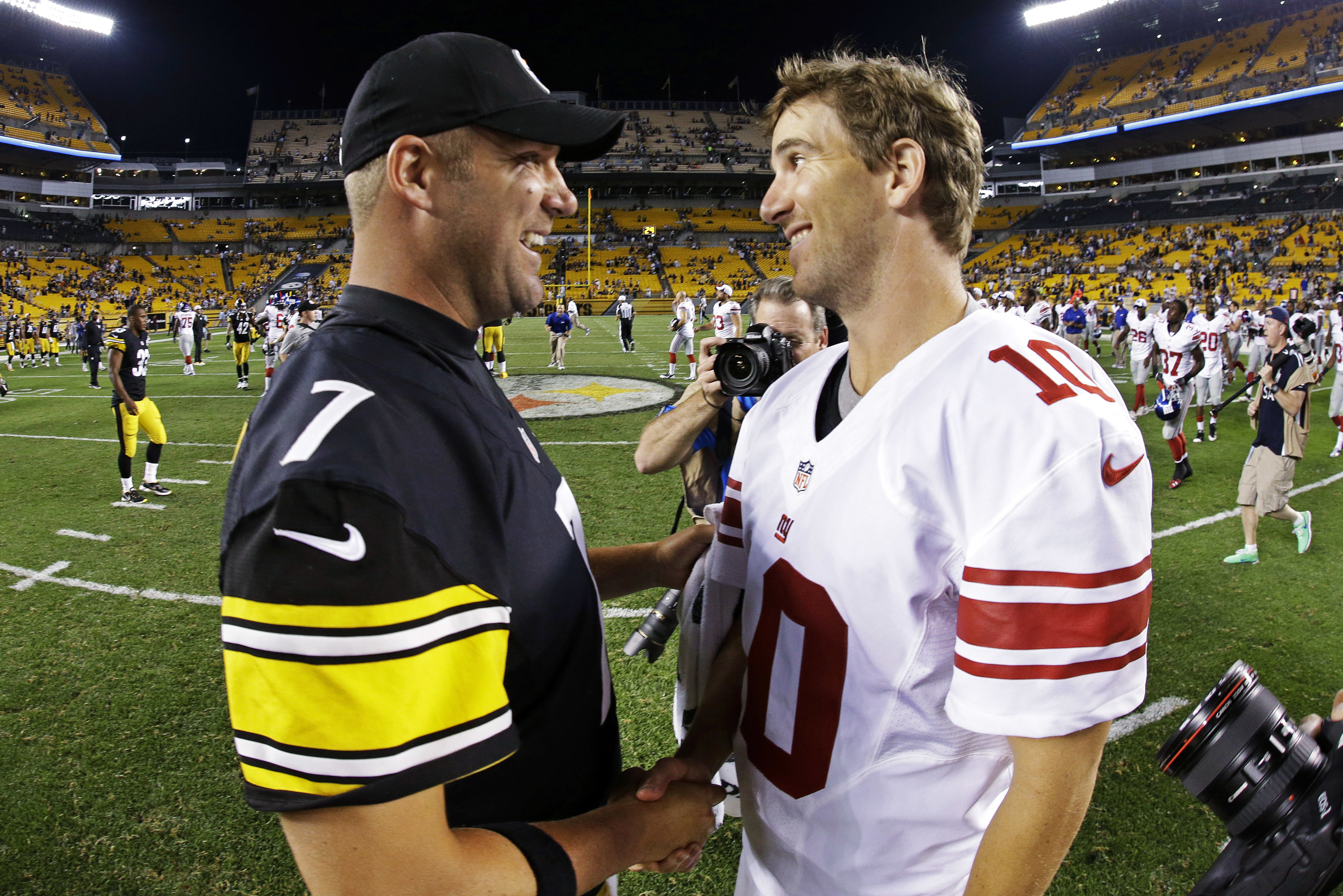 FILE - In this Aug. 10, 2013, file photo, Pittsburgh Steelers quarterback Ben Roethlisberger (7) and New York Giants quarterback Eli Manning (10) shake hands after an NFL preseason football game in Pittsburgh. Roethlisberger and Manning are inextricably l