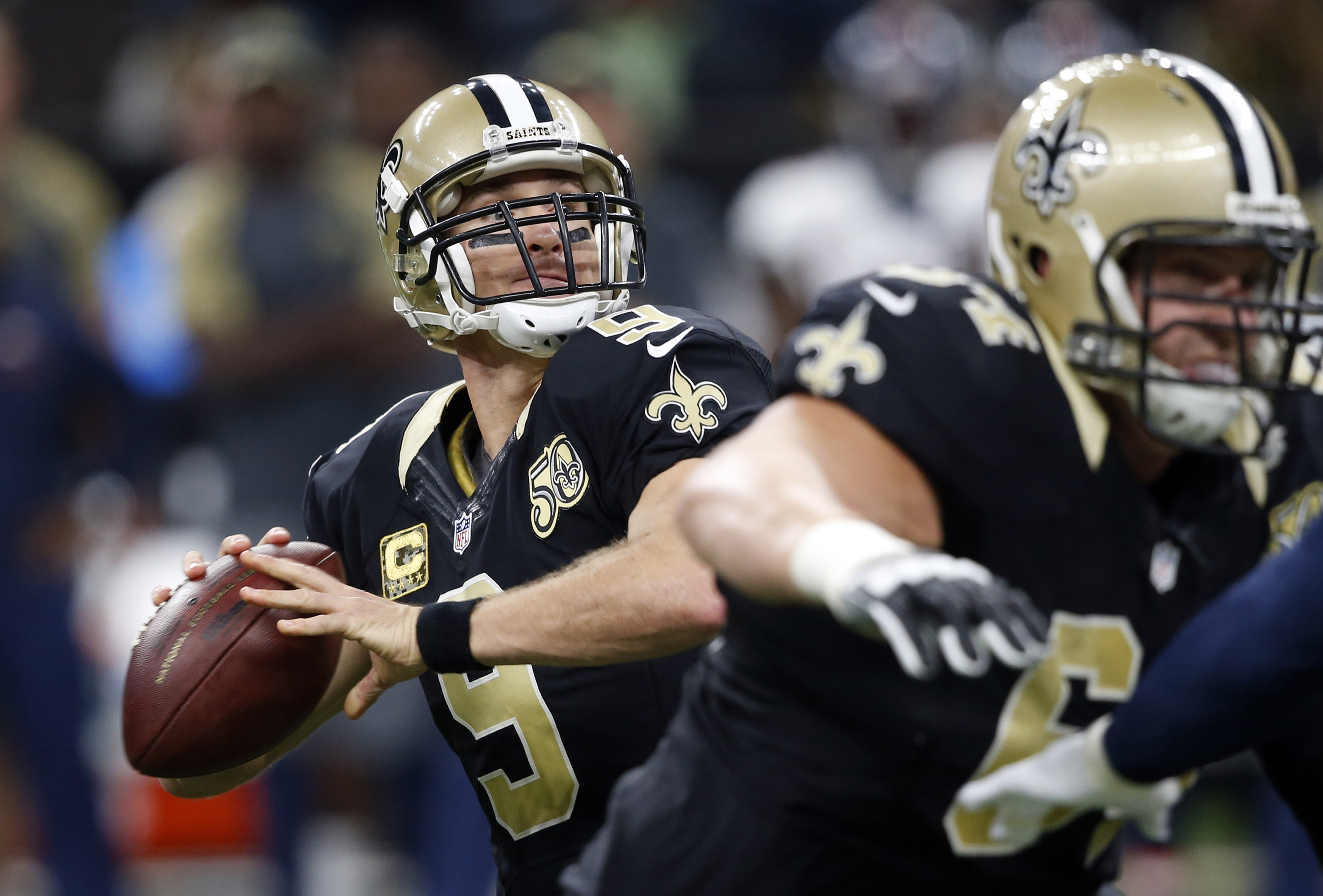 FILE - In this Sunday, Nov. 13, 2016 file photo New Orleans Saints quarterback Drew Brees (9) drops back to pass in the first half of an NFL football game against the Denver Broncos in New Orleans. The Saints play the Detroit Lions on Sunday, Dec. 4, 2016