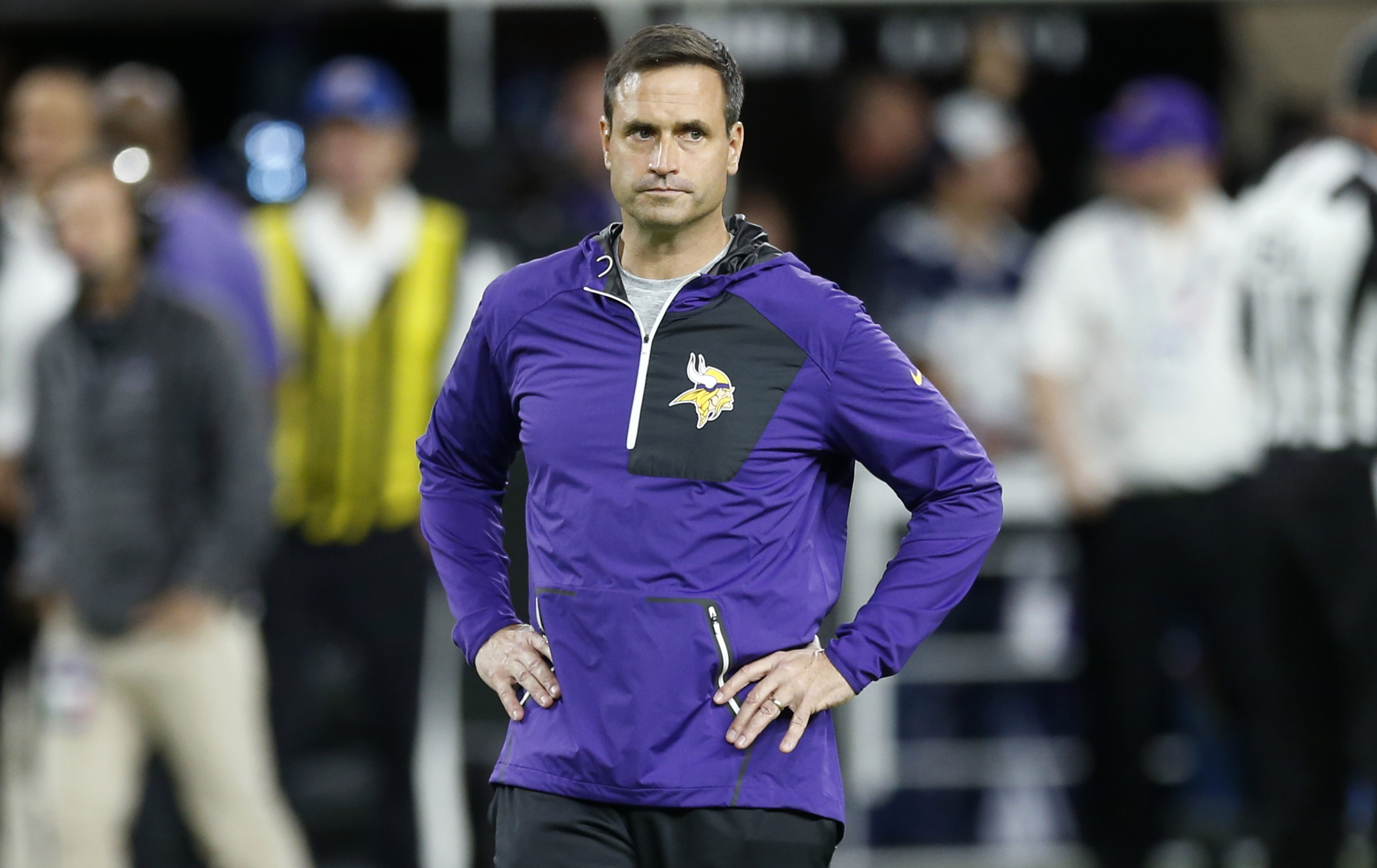 Minnesota Vikings interim coach Mike Priefer walks on the field before the team's NFL football game against Dallas Cowboys on Thursday, Dec. 1, 2016, in Minneapolis. Vikings coach Mike Zimmer missed the game following emergency surgery to repair a detache