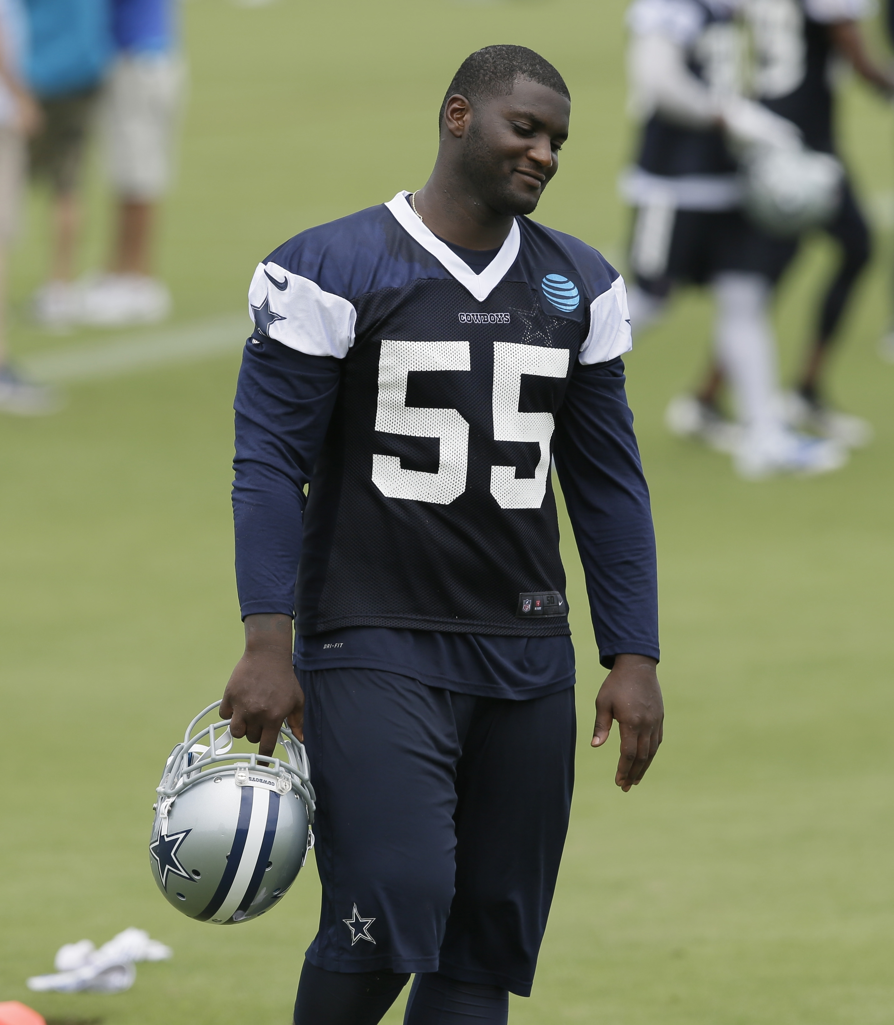 FILE - In this June 14, 2016, file photo, Dallas Cowboys linebacker Rolando McClain walks the field during the NFL football team's minicamp at Valley Ranch in Irving, Texas. McClain will miss the first 10 games for on a substance-abuse suspension, and mig