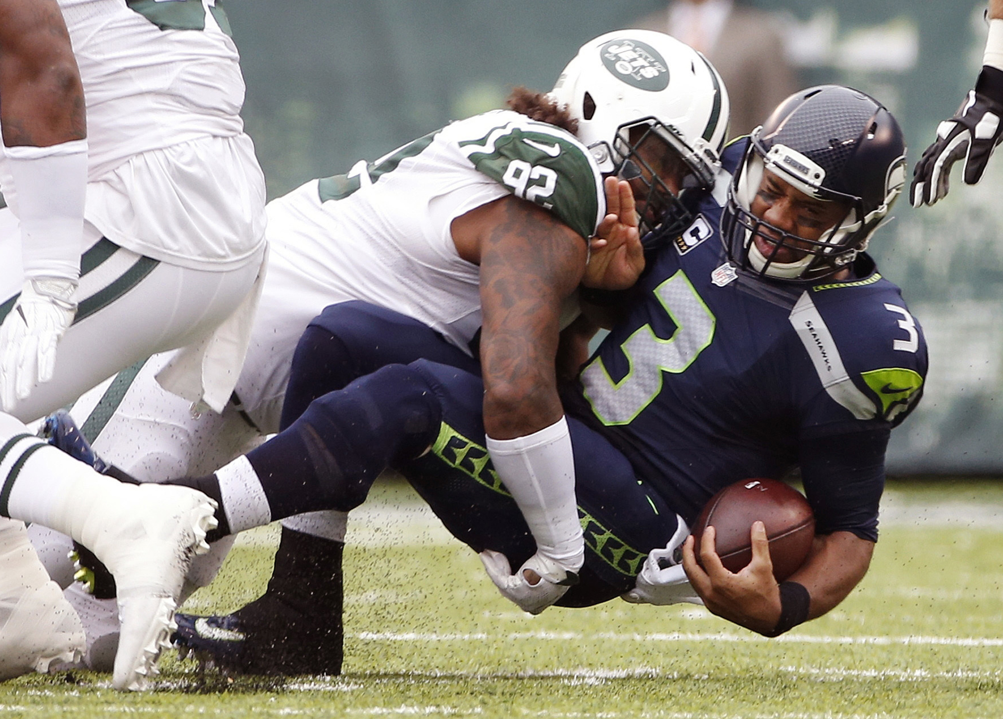 FILE - In this Oct. 2, 2016, file photo, New York Jets defensive tackle Leonard Williams (92) sacks Seattle Seahawks' Russell Wilson during  an NFL football game in East Rutherford, N.J. Williams leads the team with six sacks, 22 quarterback hits and two