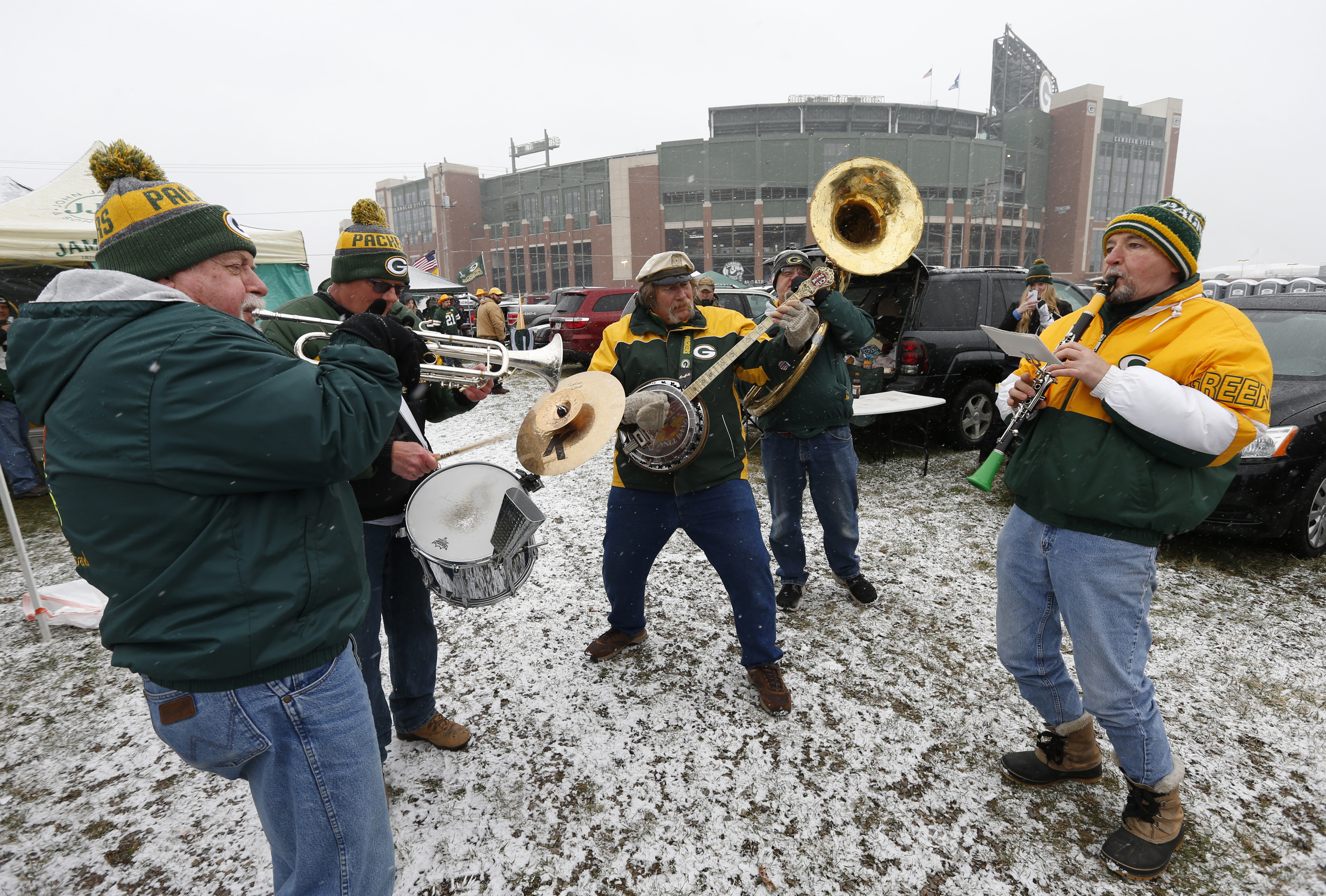 A band plays outside Lambeau Field before an NFL football game between the Green Bay Packers and the Houston Texans Sunday, Dec. 4, 2016, in Green Bay, Wis. (AP Photo/Mike Roemer)
