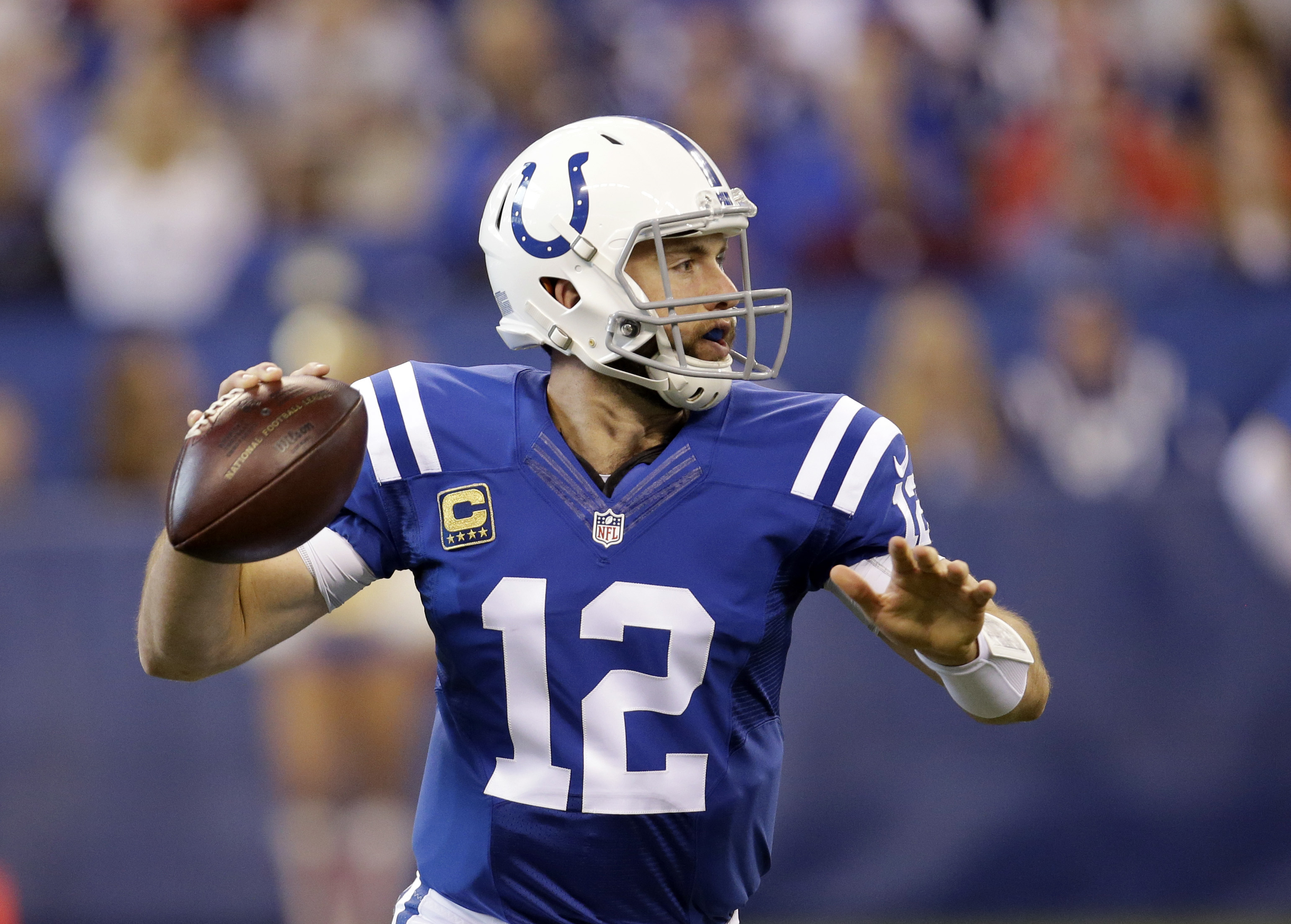 FILE - In this Sunday, Oct. 30, 2016, file photo, Indianapolis Colts quarterback Andrew Luck throws during the first half of an NFL football game against the Kansas City Chiefs, in Indianapolis. Luck is coming off a concussion that sidelined him for one g