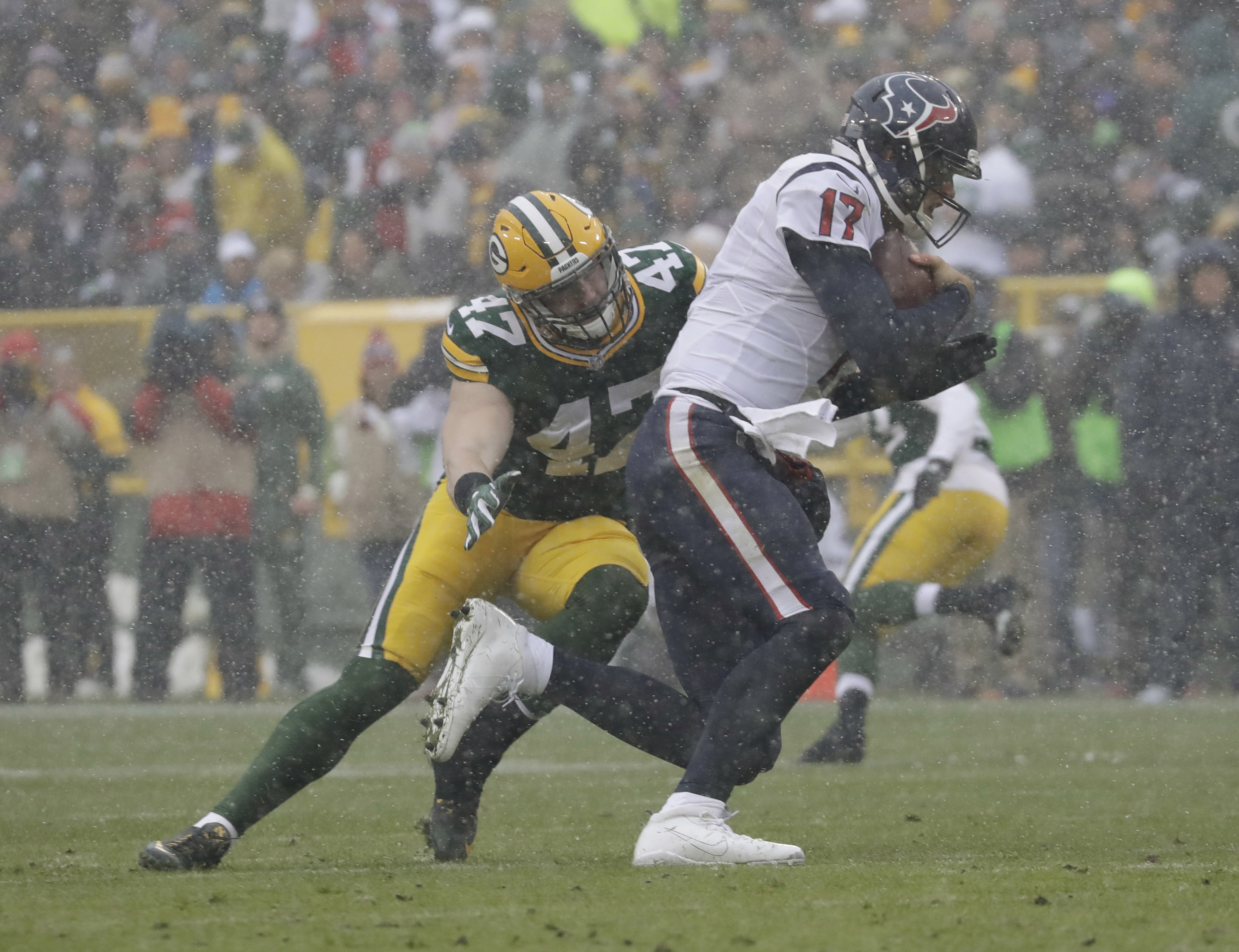 Houston Texans' Brock Osweiler runs away from Green Bay Packers' Jake Ryan during the first half of an NFL football game Sunday, Dec. 4, 2016, in Green Bay, Wis. (AP Photo/Morry Gash)