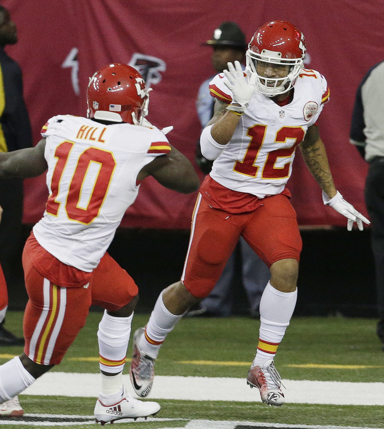 Kansas City Chiefs wide receiver Albert Wilson (12) celebrates his interception and touchdown with Kansas City Chiefs wide receiver Tyreek Hill (10) during the second half of an NFL football game against the Atlanta Falcons, Sunday, Dec. 4, 2016, in Atlan